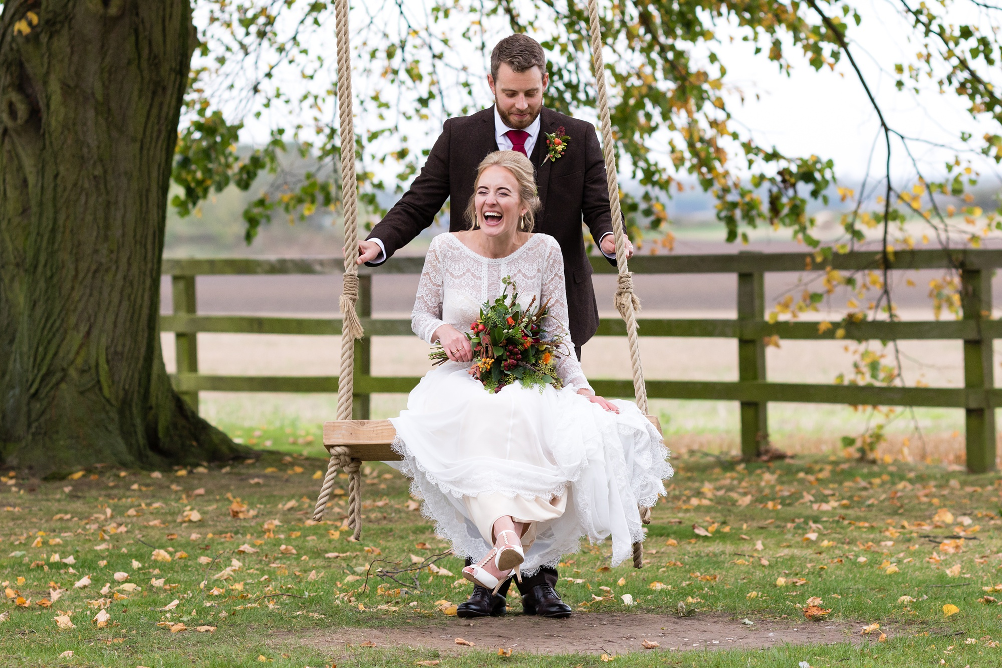 Barmbyfield Barn Wedding Photography Autumnal wedding bride and groom on swing