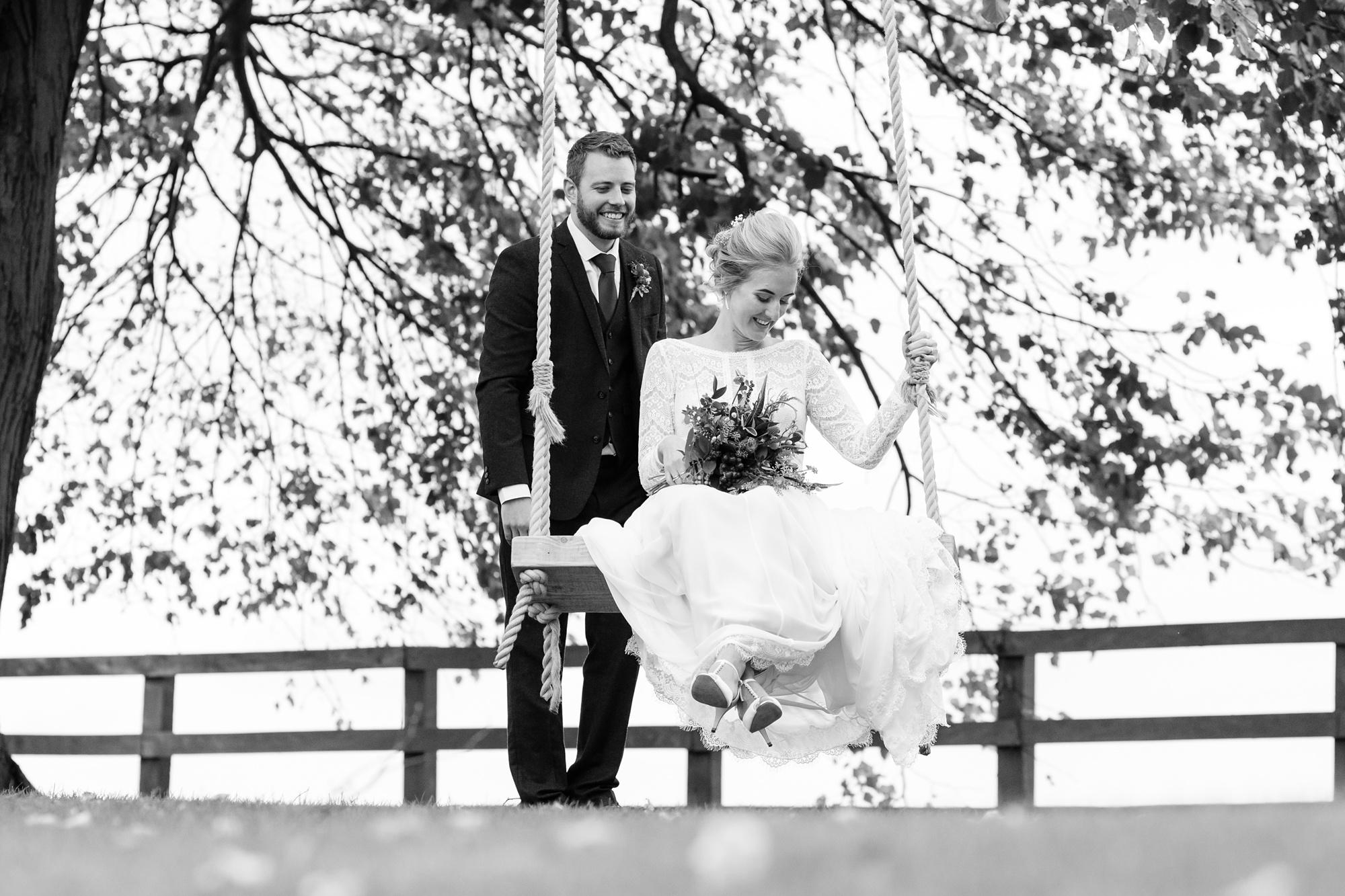 Barmbyfield Barn Wedding Photography the couple on a swing