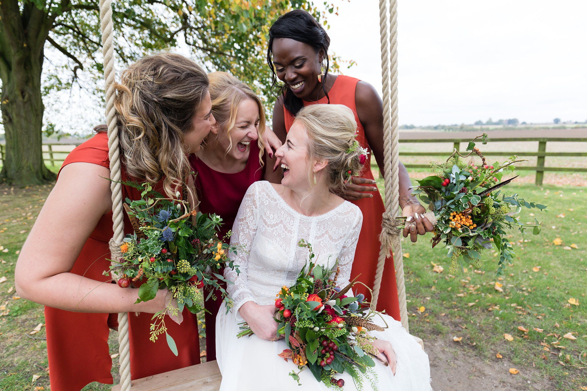 Yorkshire Wedding Photographers at Barmbyfield Barn smiling and laughing with bridesmaids