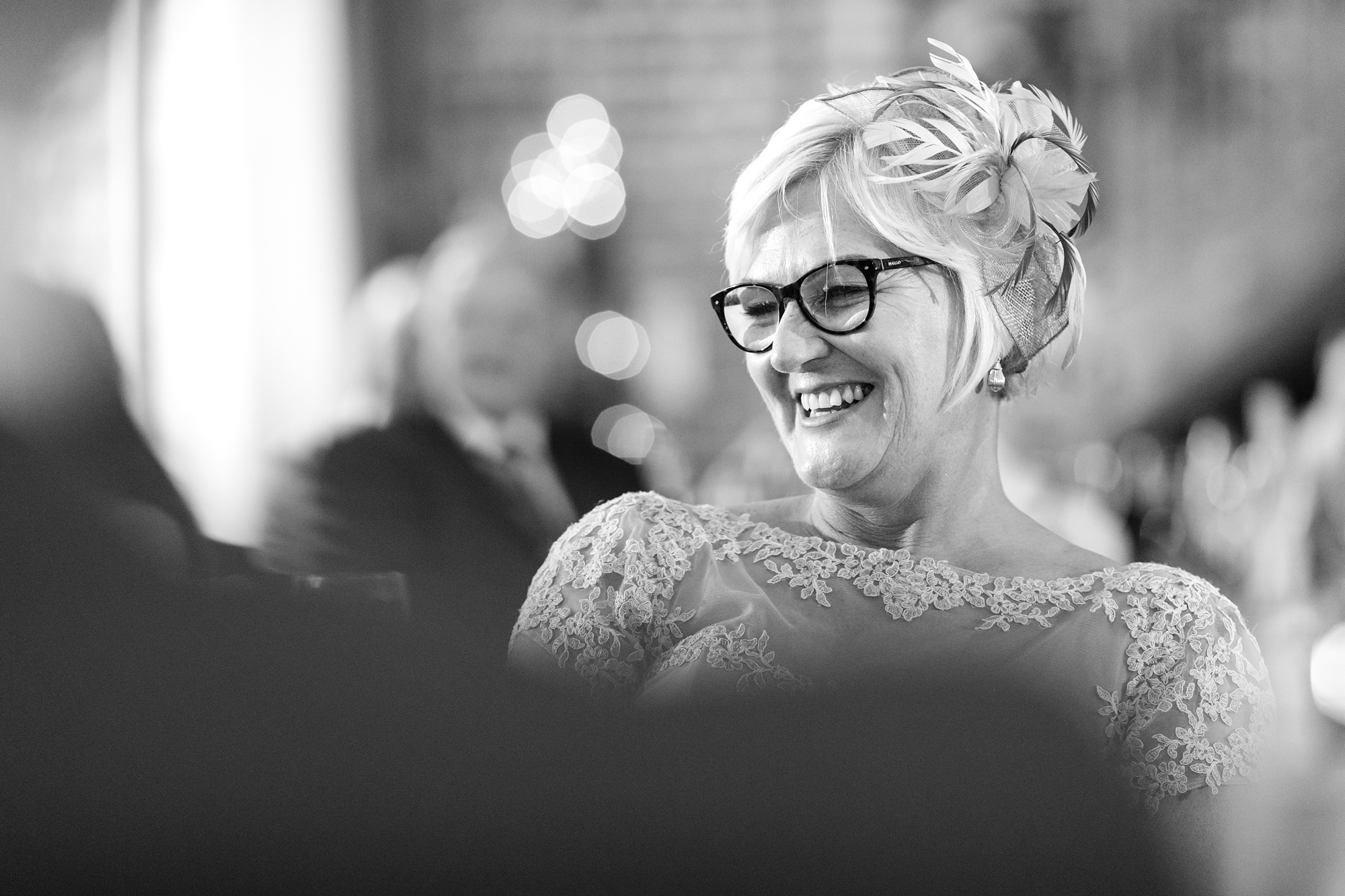 Bride's mum laughing and smiling during speechs