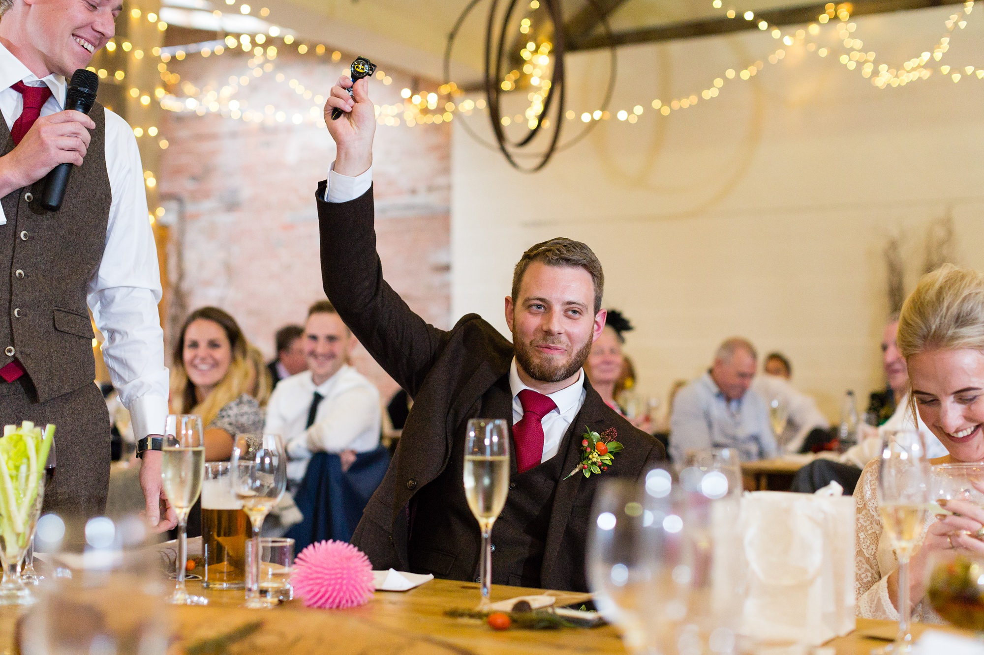 Yorkshire Wedding Photographers at Barmbyfield Barn Groom holds his hand up high
