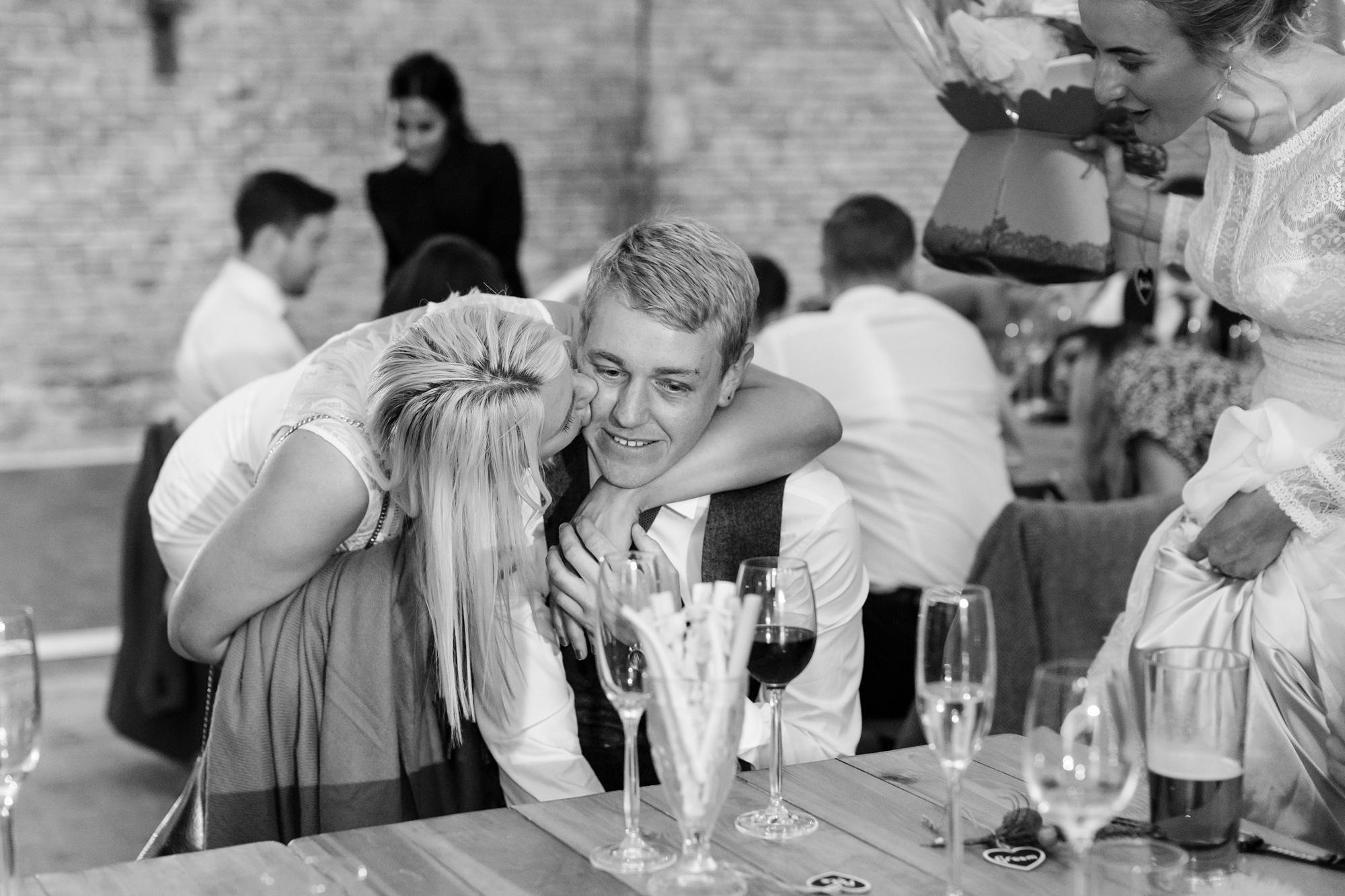 Girlfriend kisses best man on the cheek