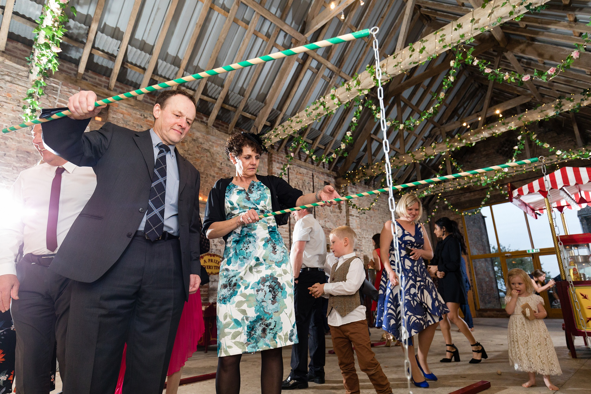 Yorkshire Wedding Photographers guests attending an indoor fun fayre