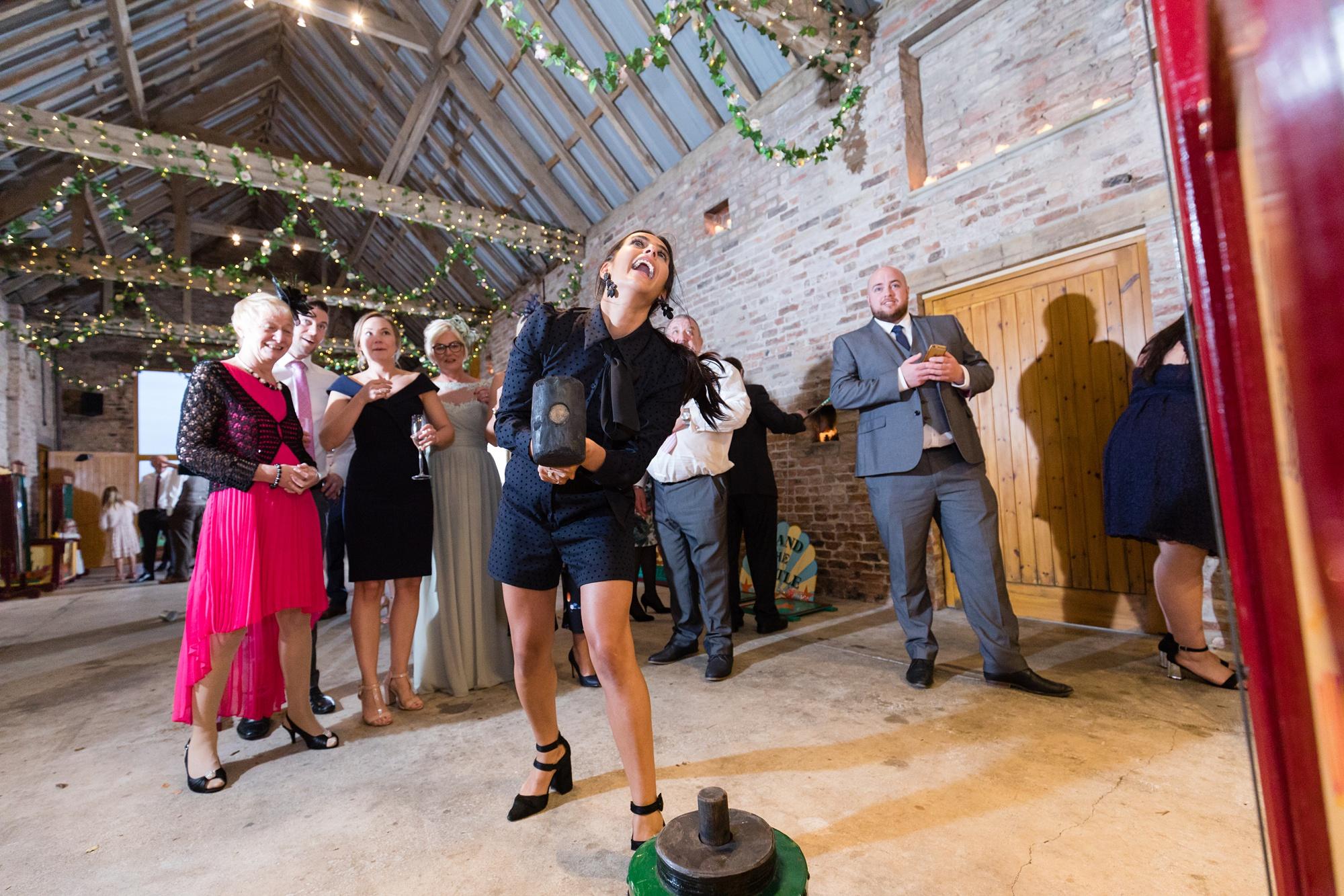 Barmbyfield Barn Wedding Photography guest having a fun time at indoor fun fair