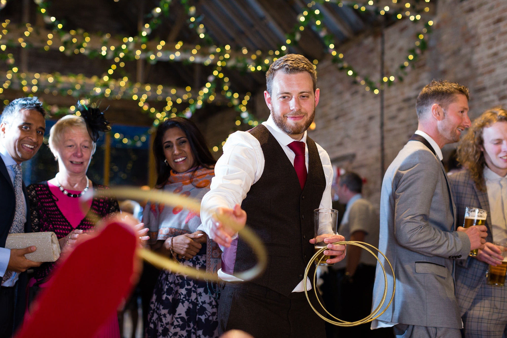 Yorkshire Wedding Photographers Ring toss with groom