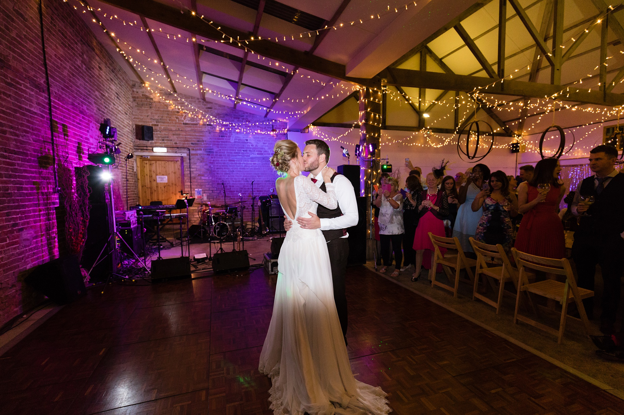 Yorkshire Wedding Photographers first dance under purple lights