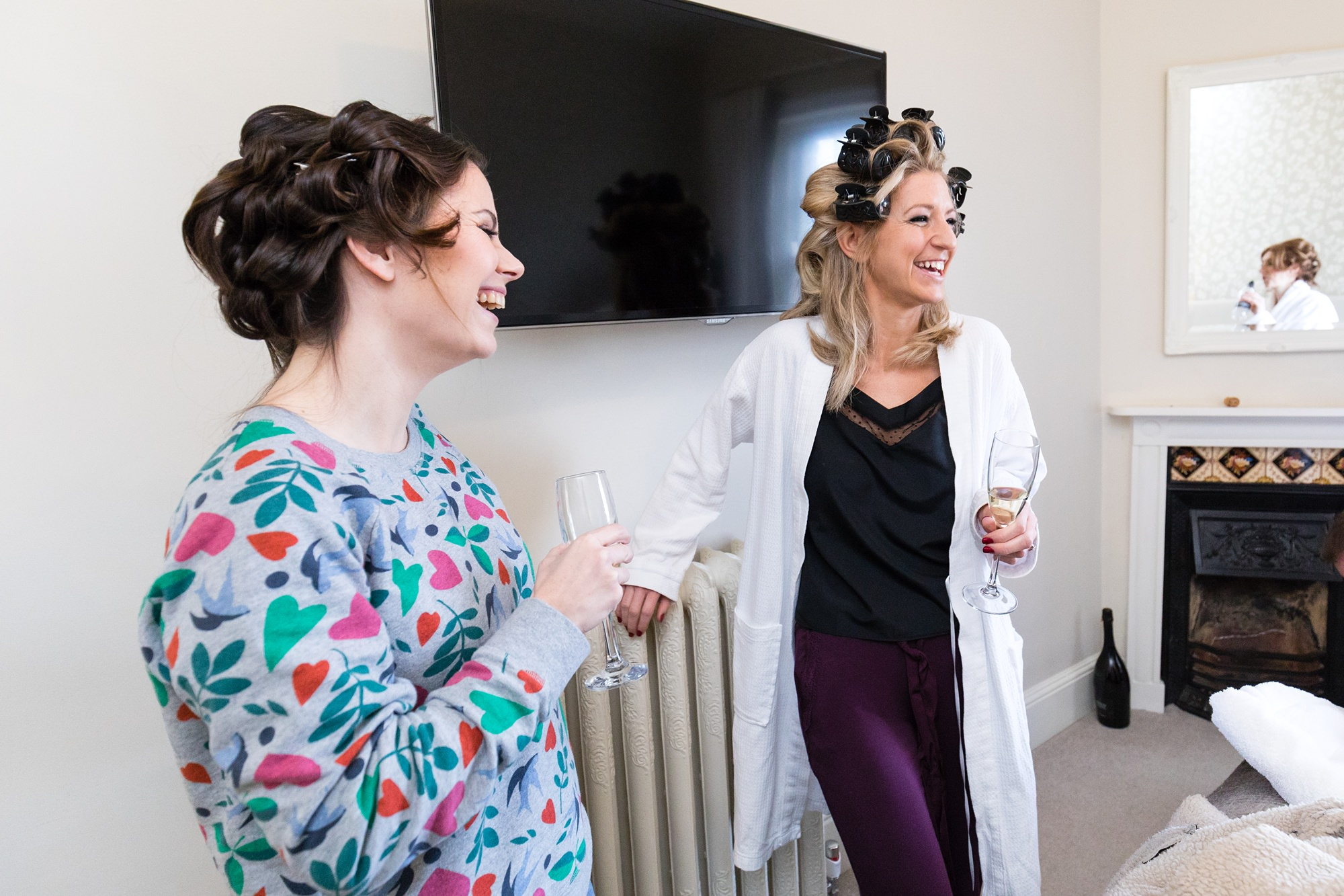 York Wedding Photography at Hornington Manor Farm bride laughing with bridesmaids with curlers in hair