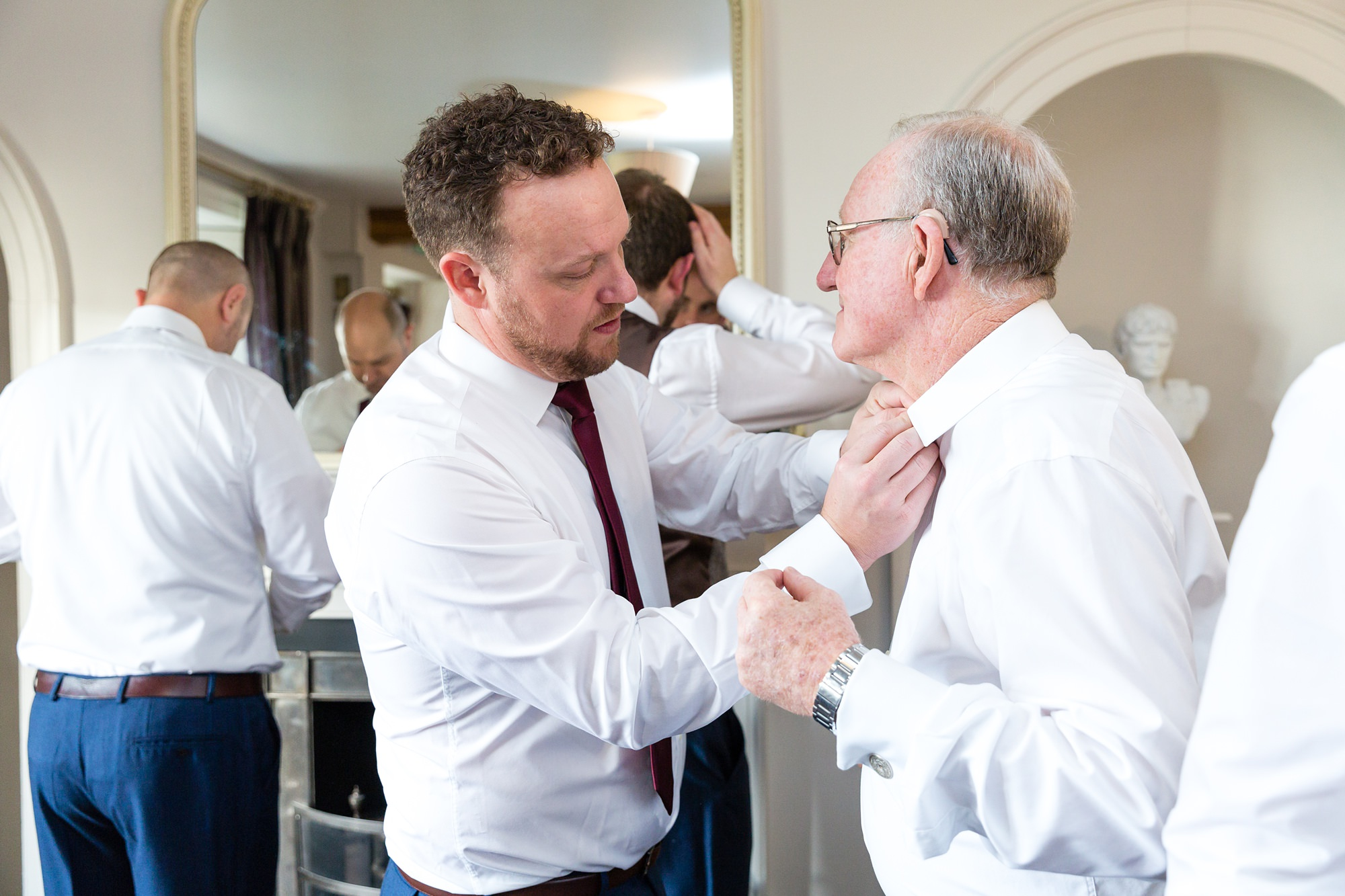 Groom helps his dad with buttonhole