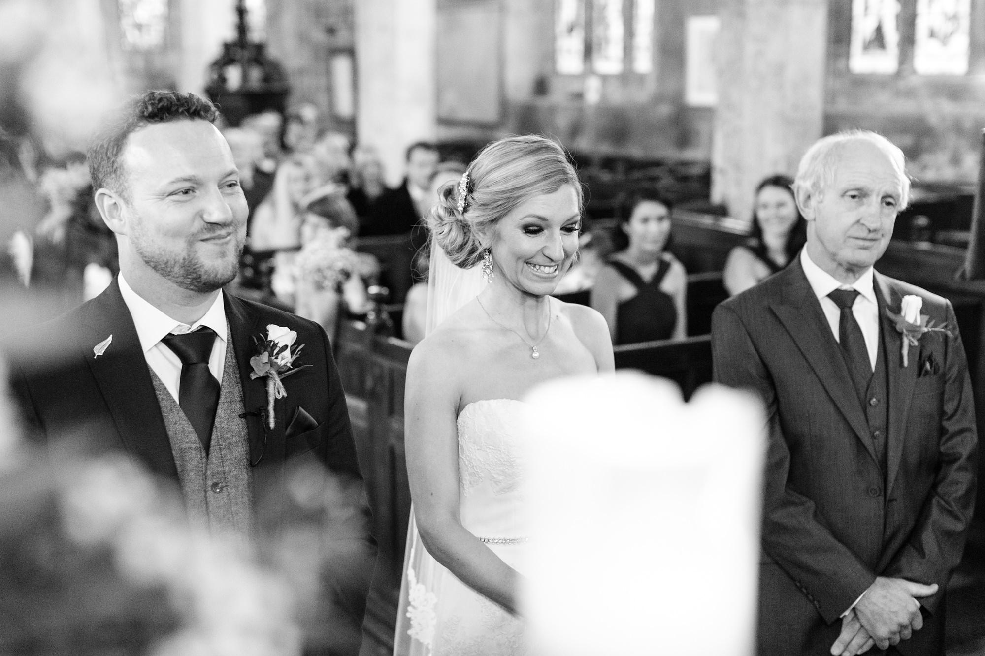 Bride smiles during ceremony at church