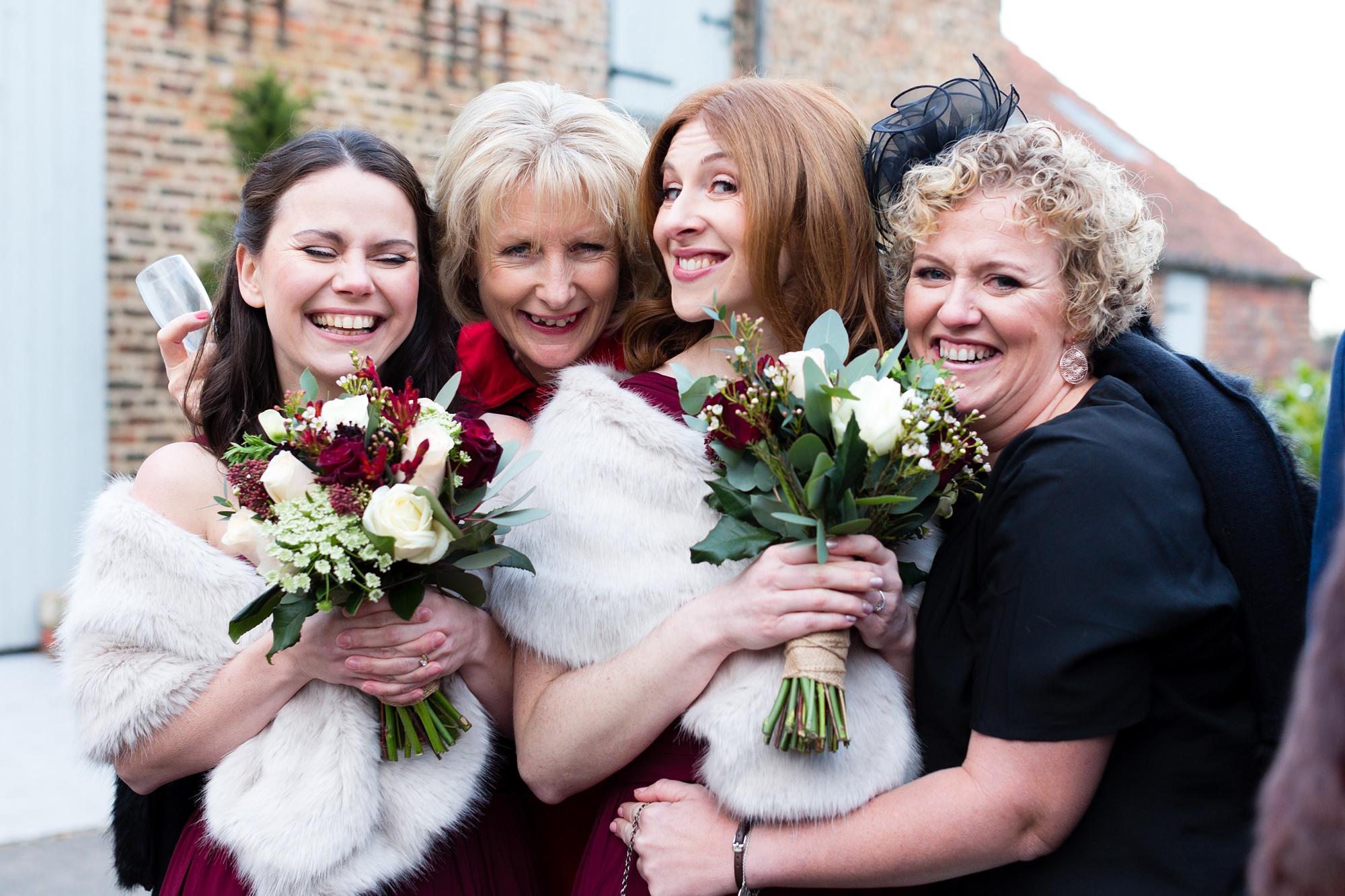 Wedding guests smile and hug at York wedding