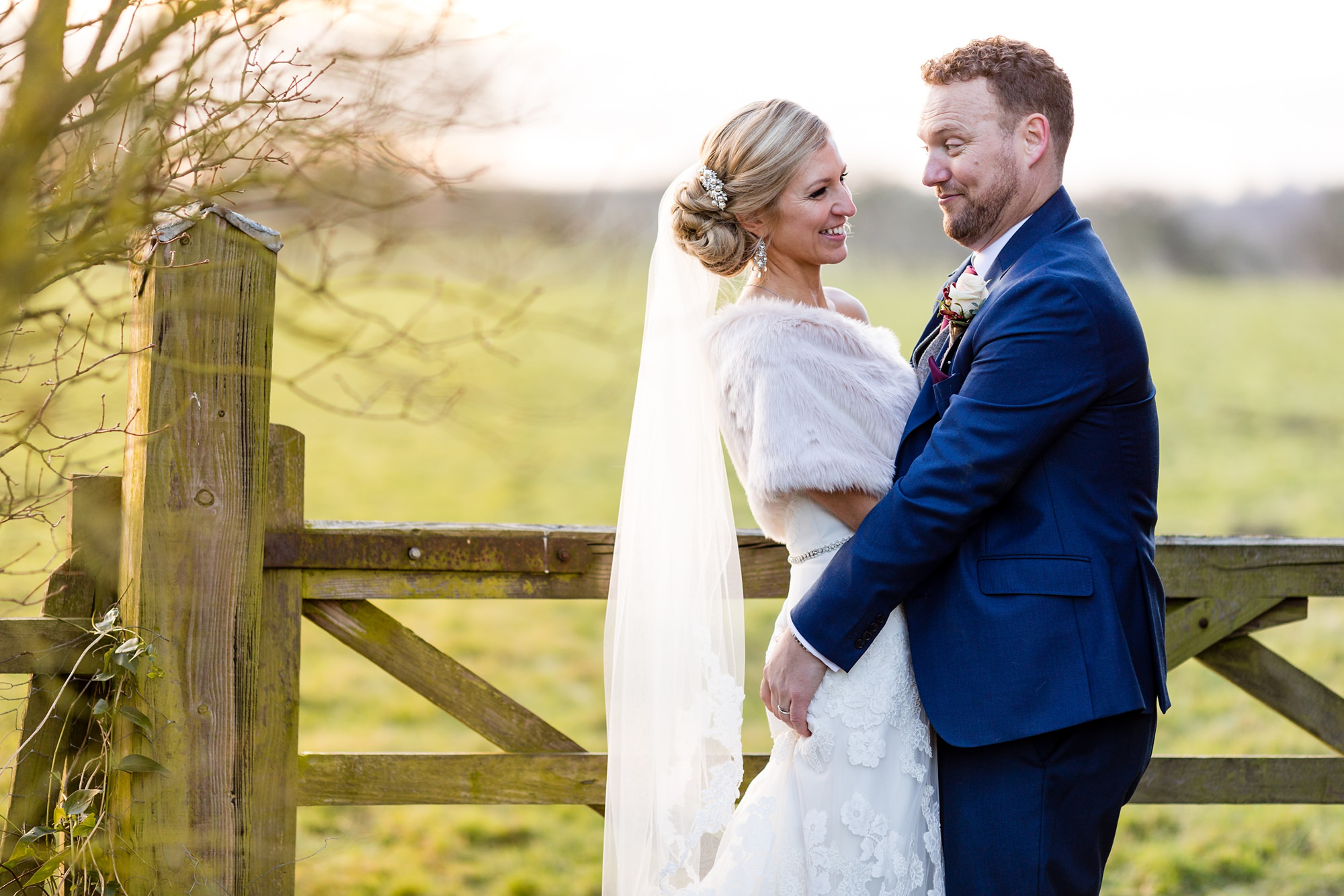 Groom makes silly faces during portraits at Hornington Manor Farm York Wedding
