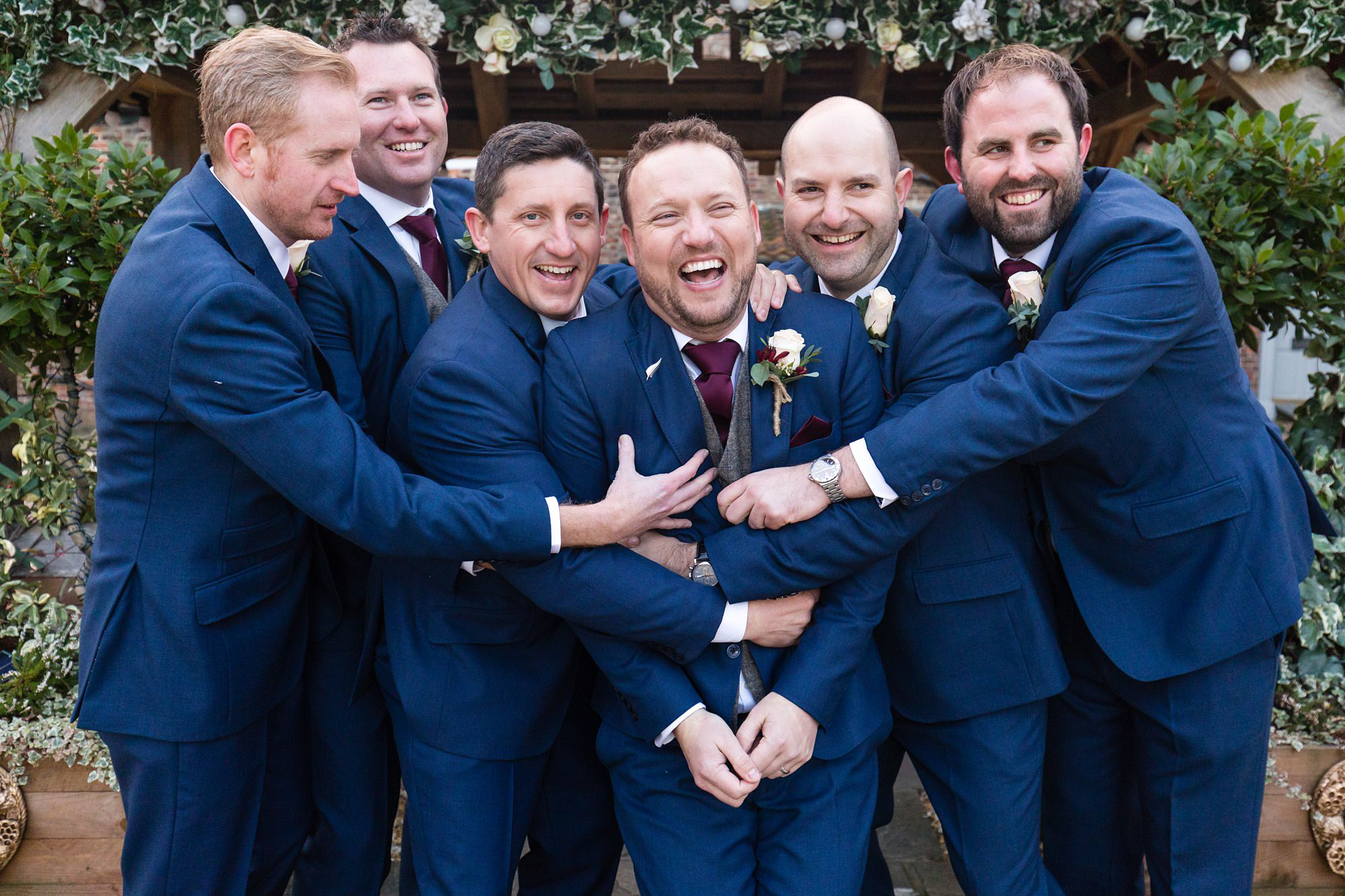 Groomsmen hug Groom at York Wedding
