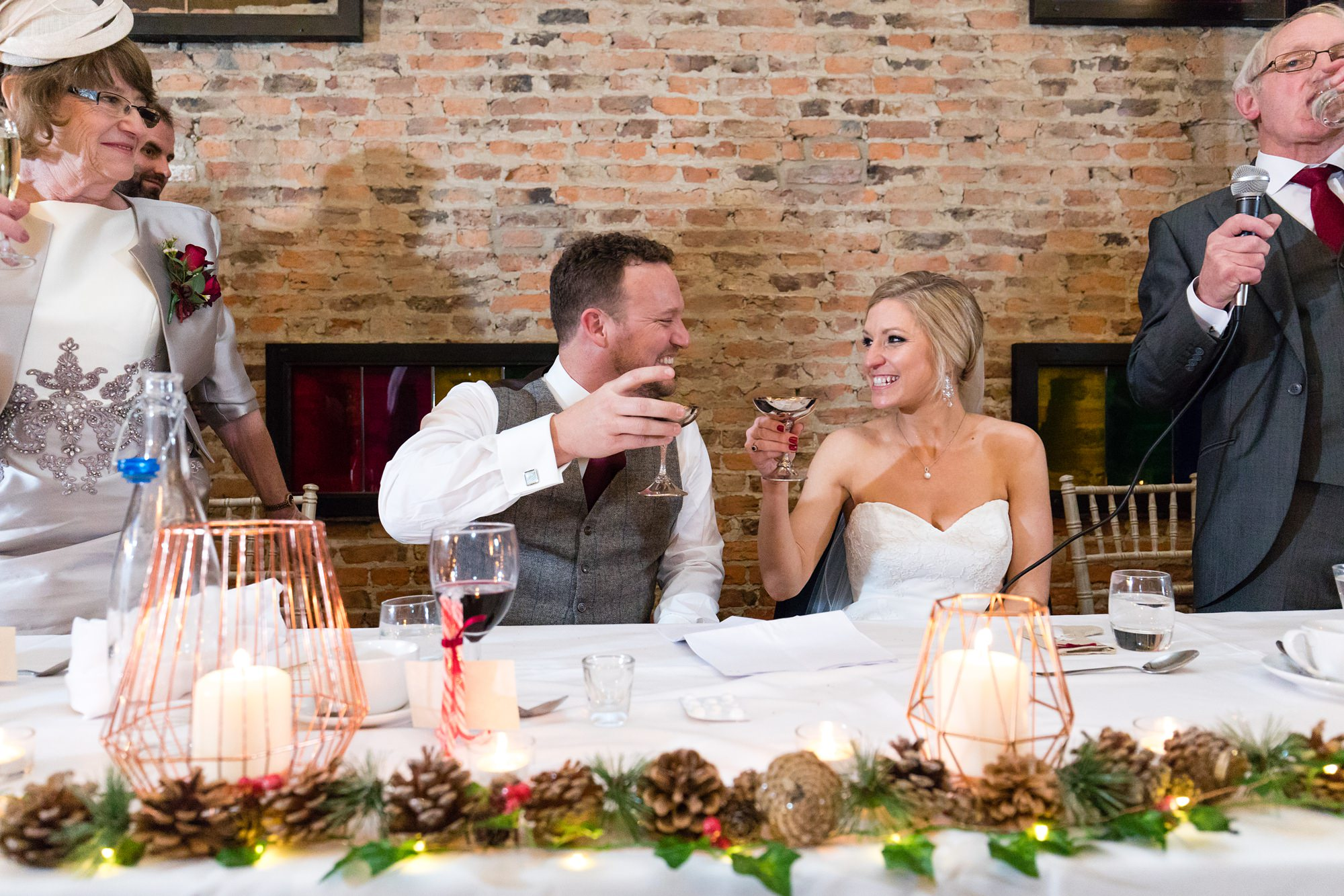 Bride and Groom toast each other during speeches at York Wedding