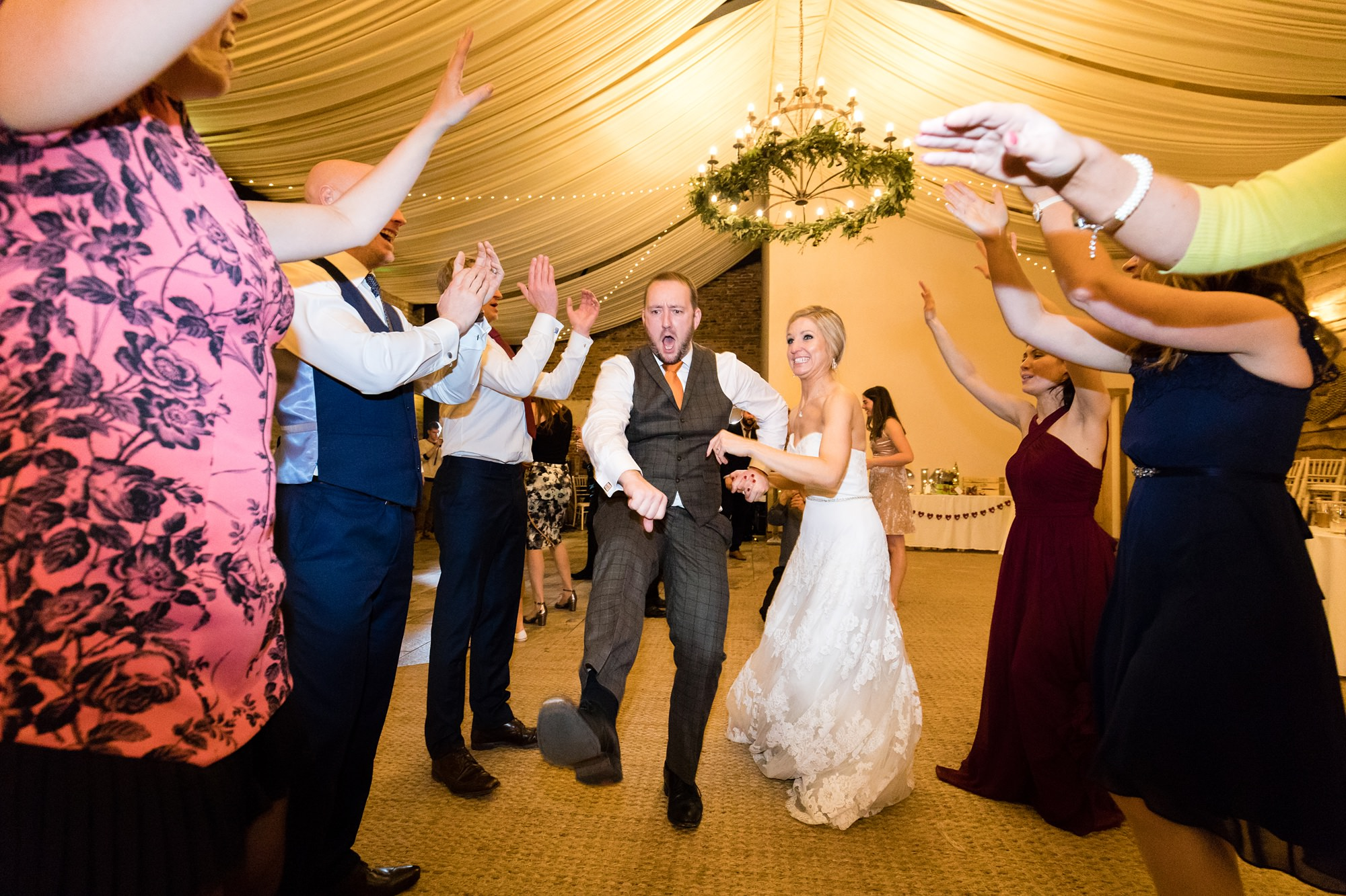 Bride and friend dance during party