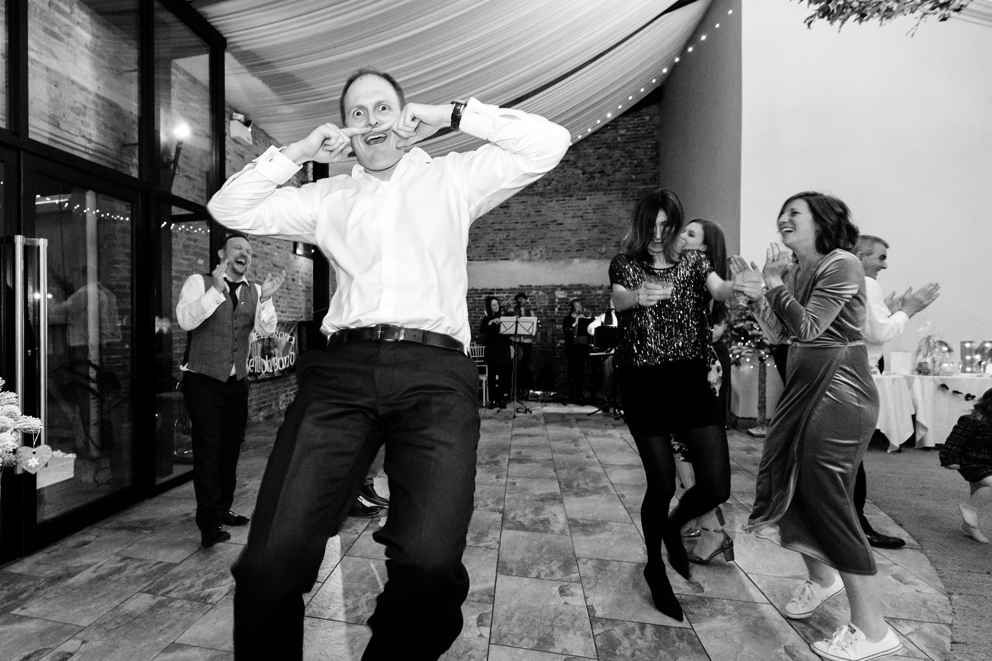 Guests being silly whilst dancing at York Wedding