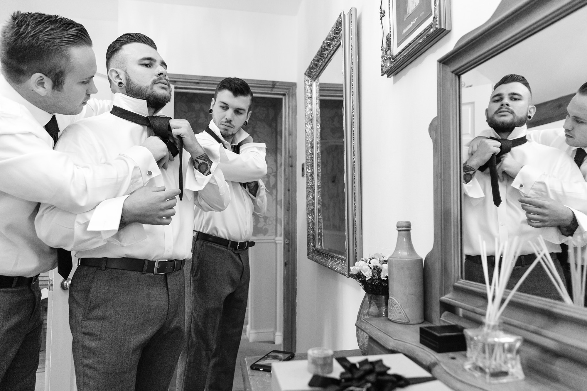 Yorkshire Wedding Photography at Crab and Lobster groom gets ready with groomsman's help