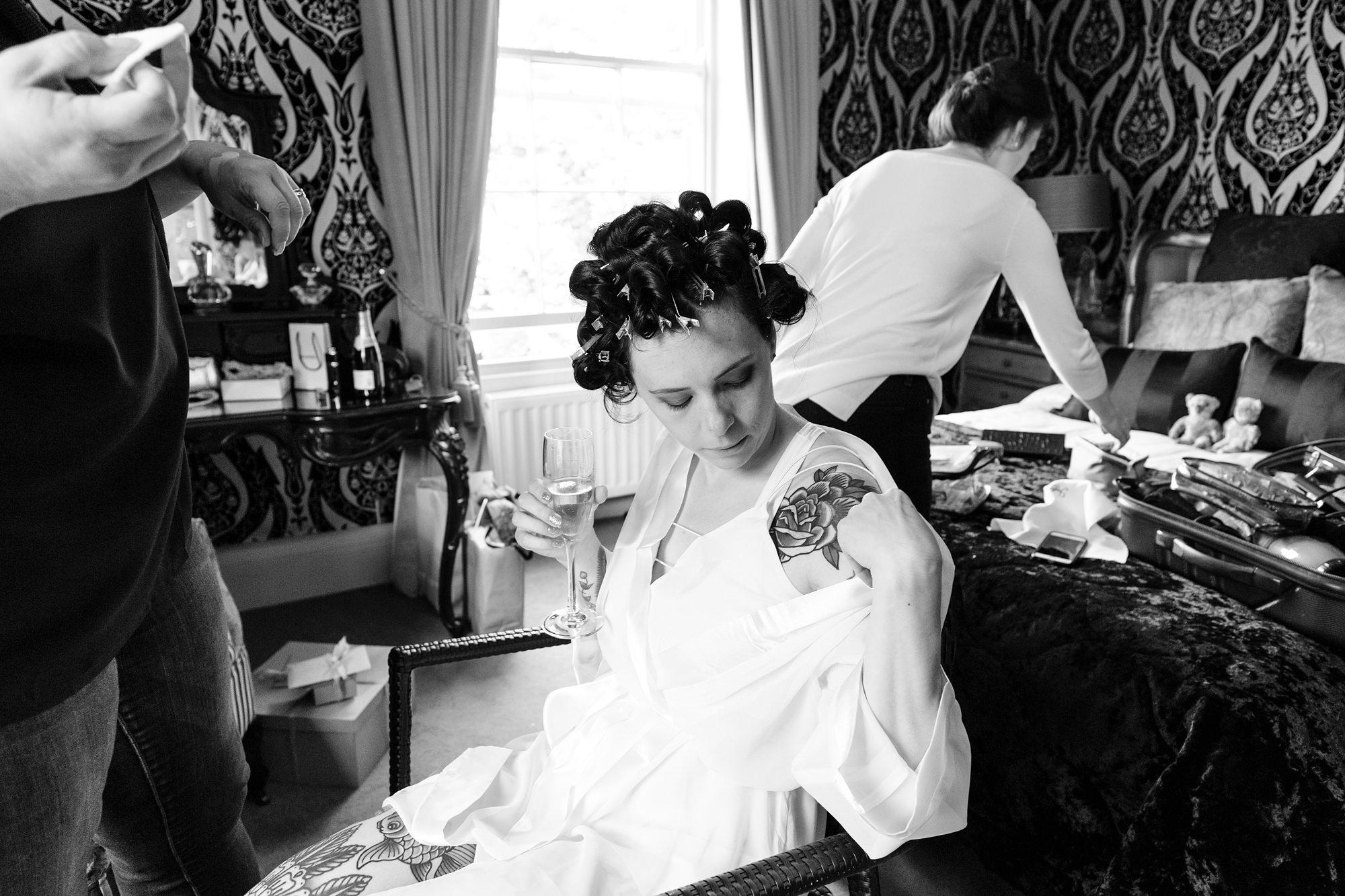 Tattooed bride shows shoulder