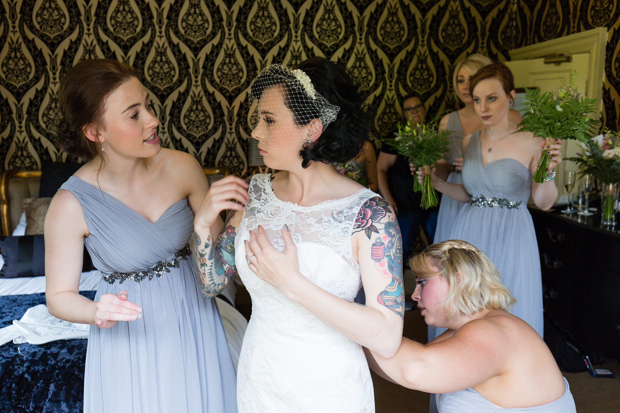 Yorkshire Wedding Photography at Crab and Lobster bride gets into dress