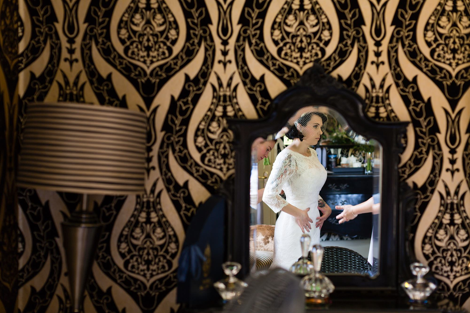 Yorkshire Wedding Photography at Crab and Lobster reflection of bride as she gets into dress