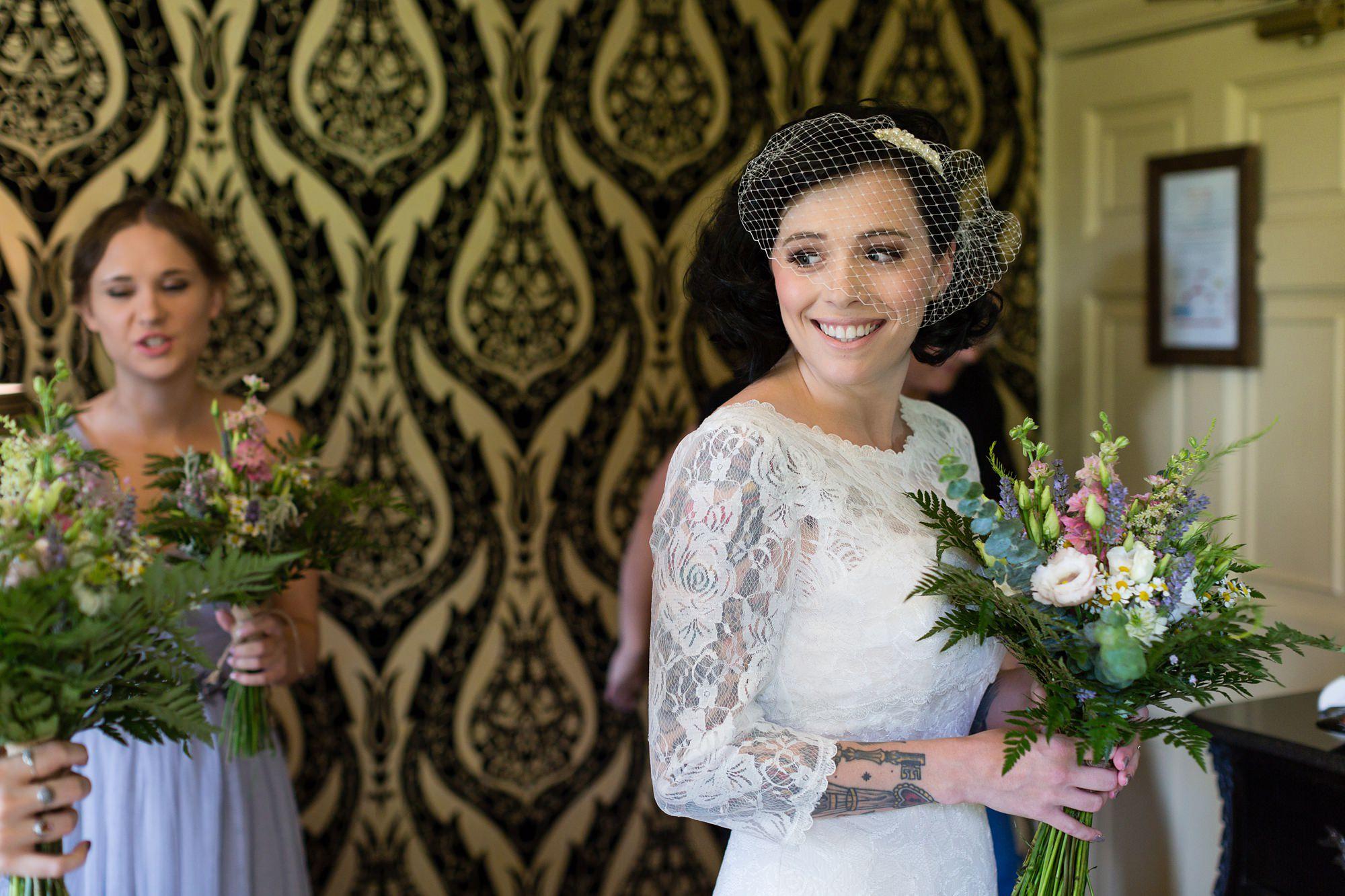 Bride smiles holding bouquet
