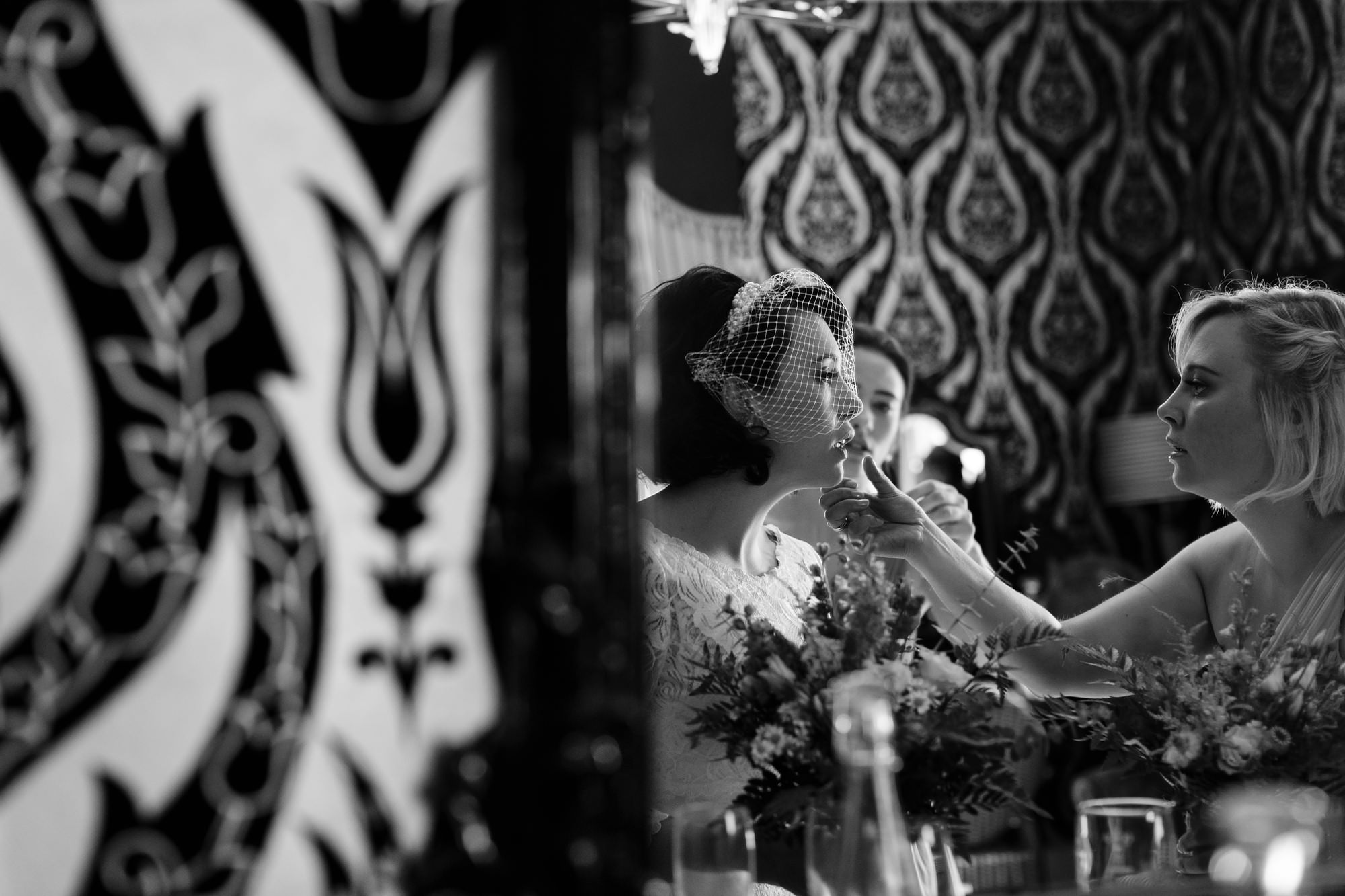 Yorkshire Wedding Photography at Crab and Lobster bride has makeup applied in reflection of mirror