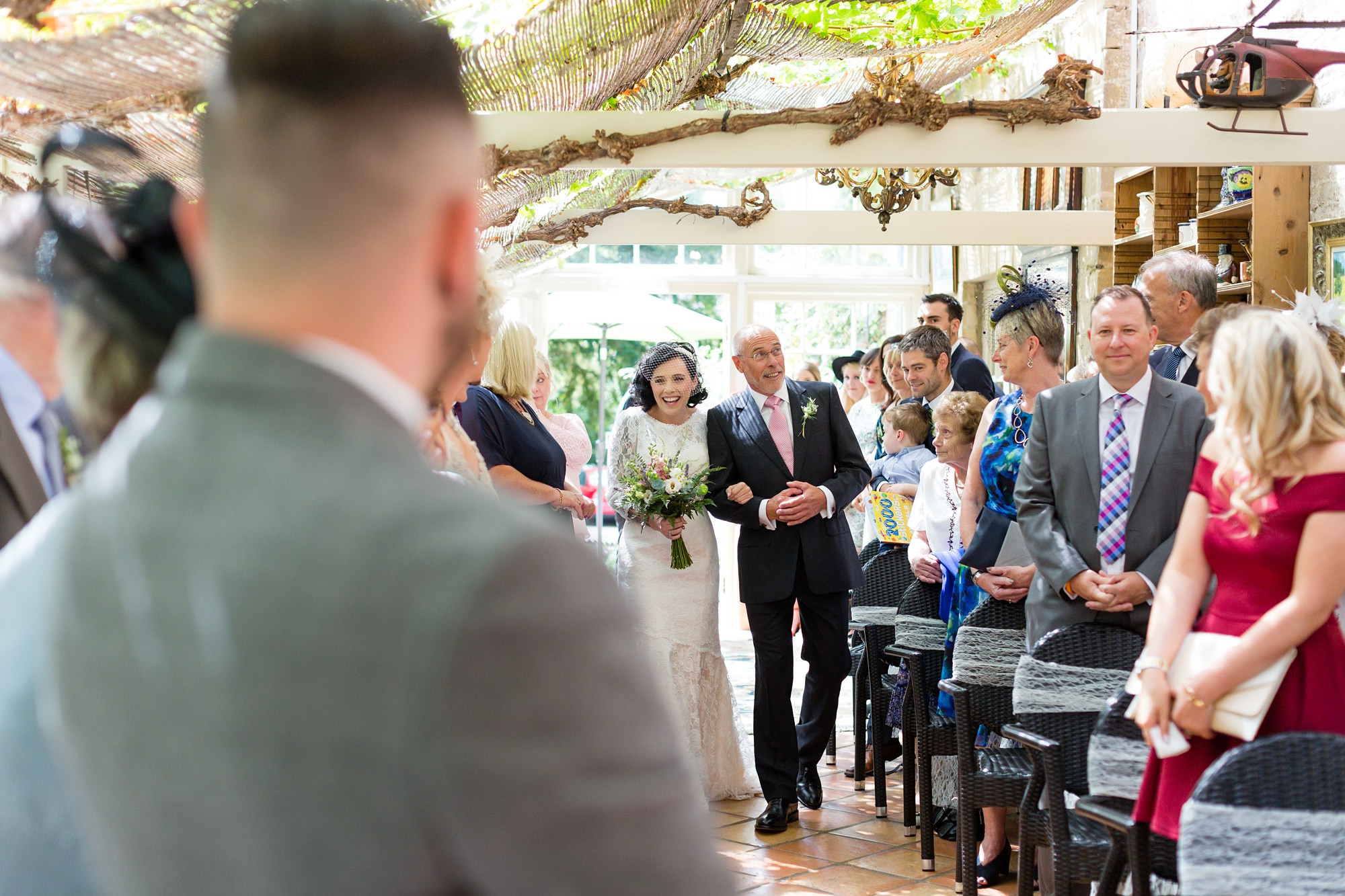Yorkshire Wedding Photography at Crab and Lobster walking up the aisle