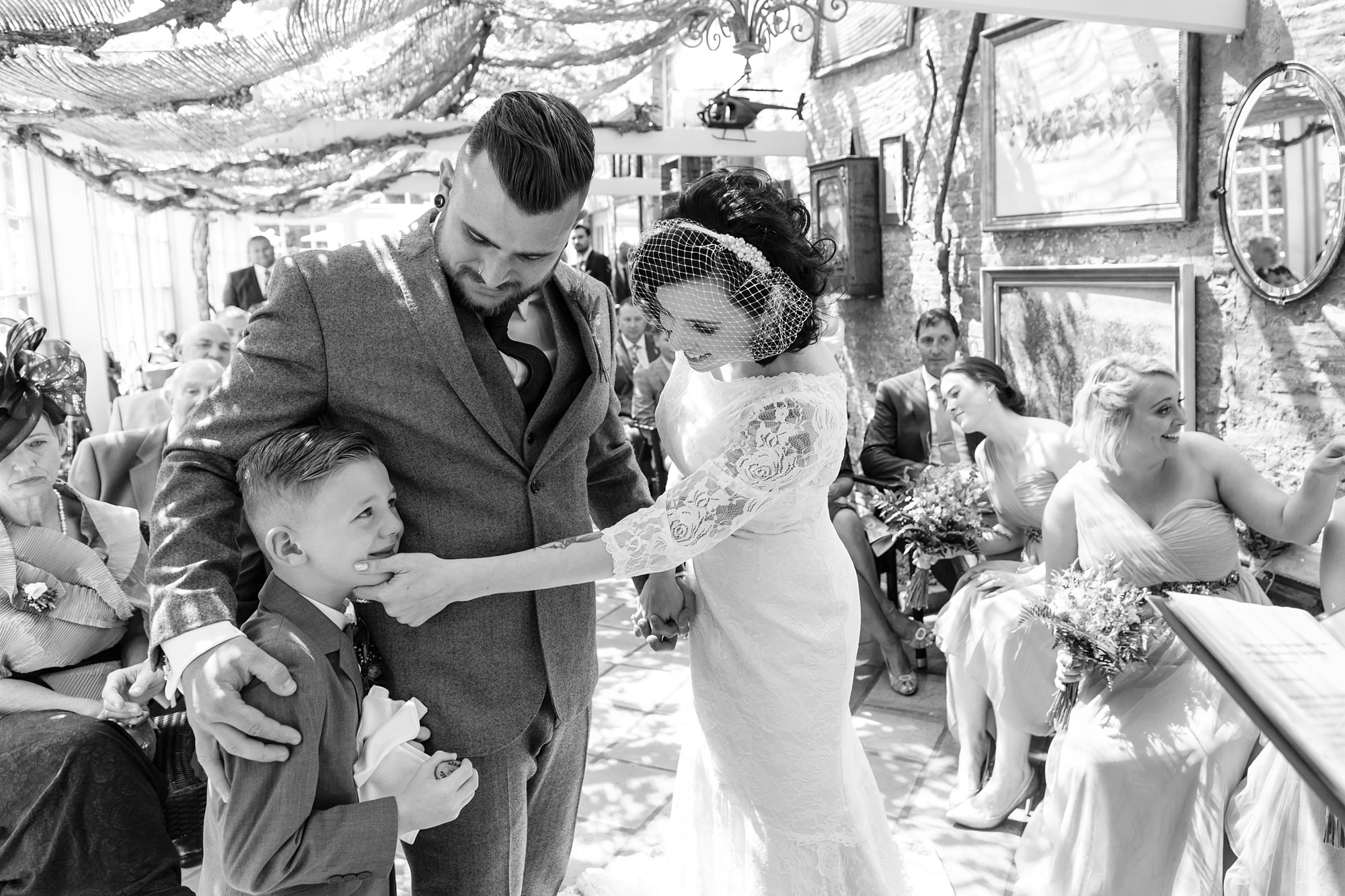 Yorkshire Wedding Photography at Crab and Lobster bride wipes away tears from emotional stepson