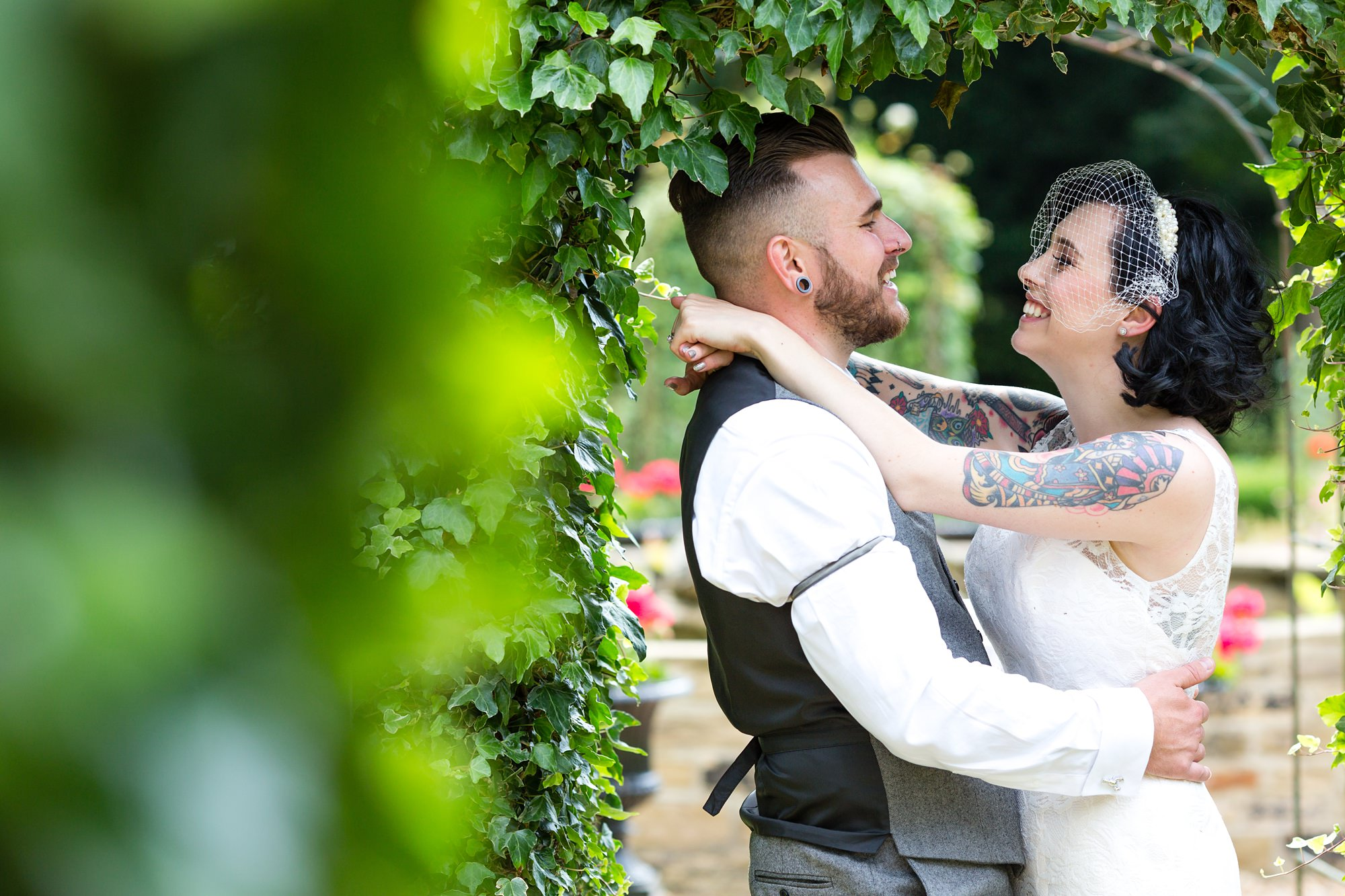 Tattooed bride and groom at Crab and Lobster wedding