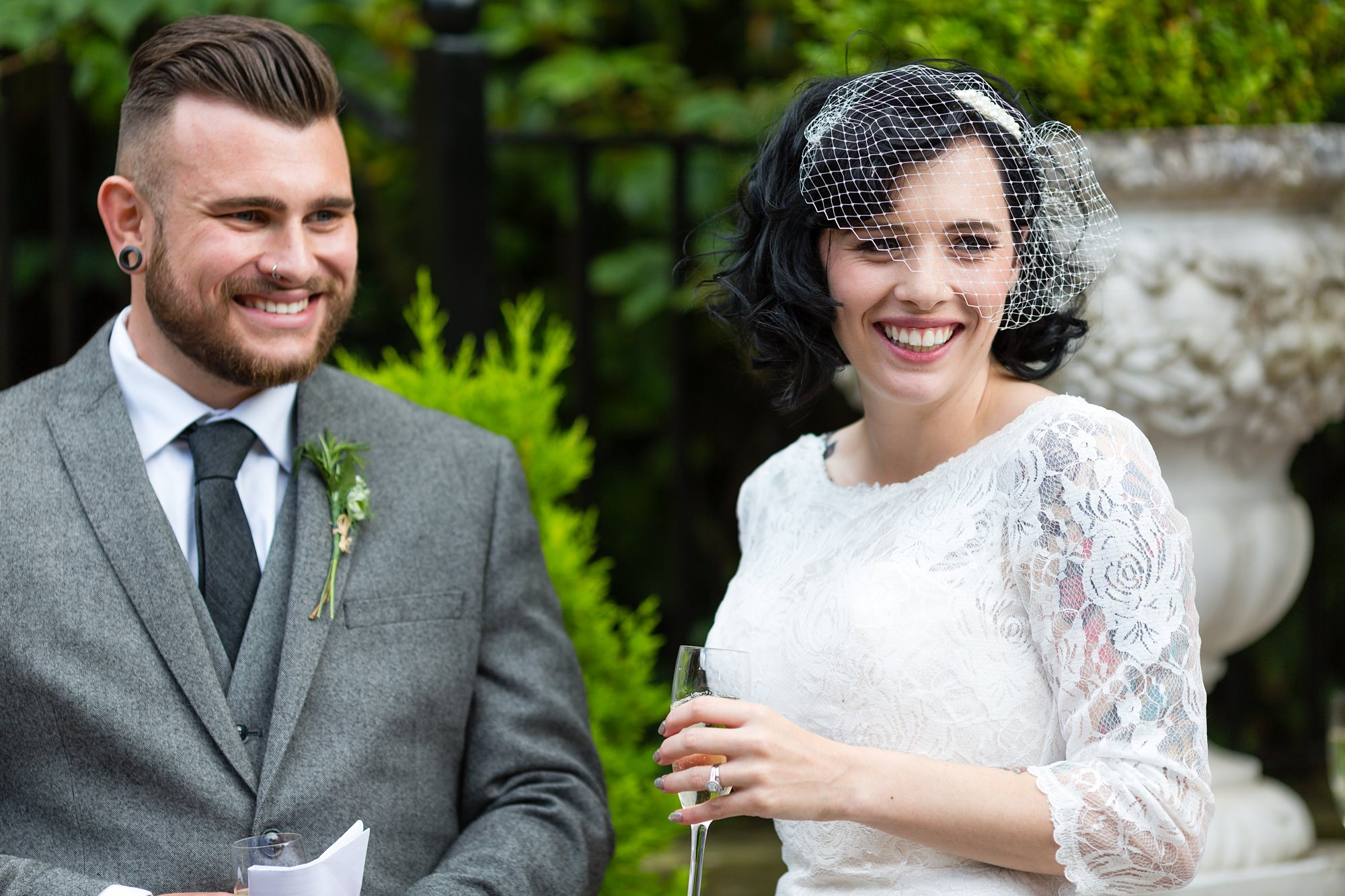 Yorkshire Wedding Photography at Crab and Lobster bride and groom smile during speeches
