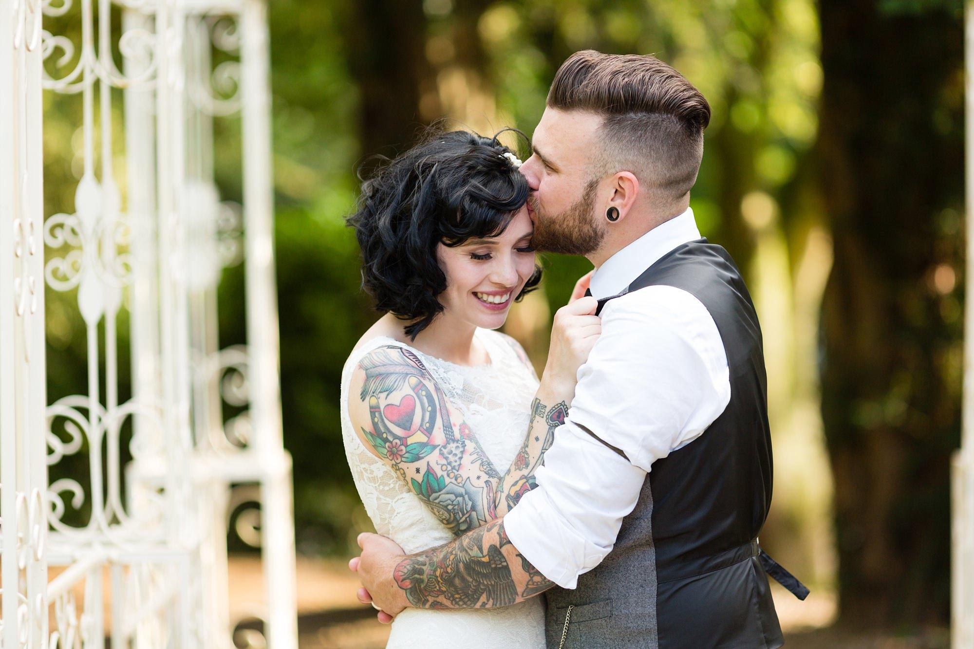 Tattooed couple kiss at Yorkshire wedding