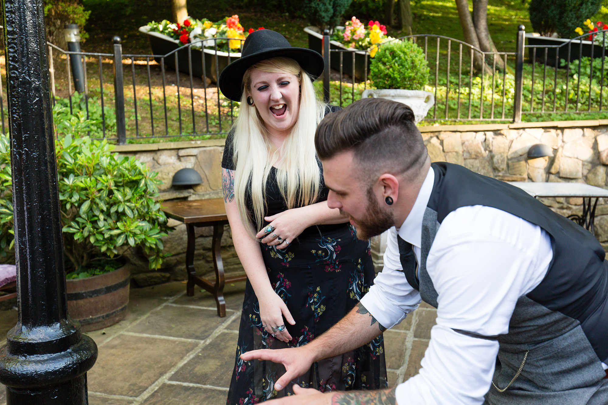 wedding guest laughs with groom