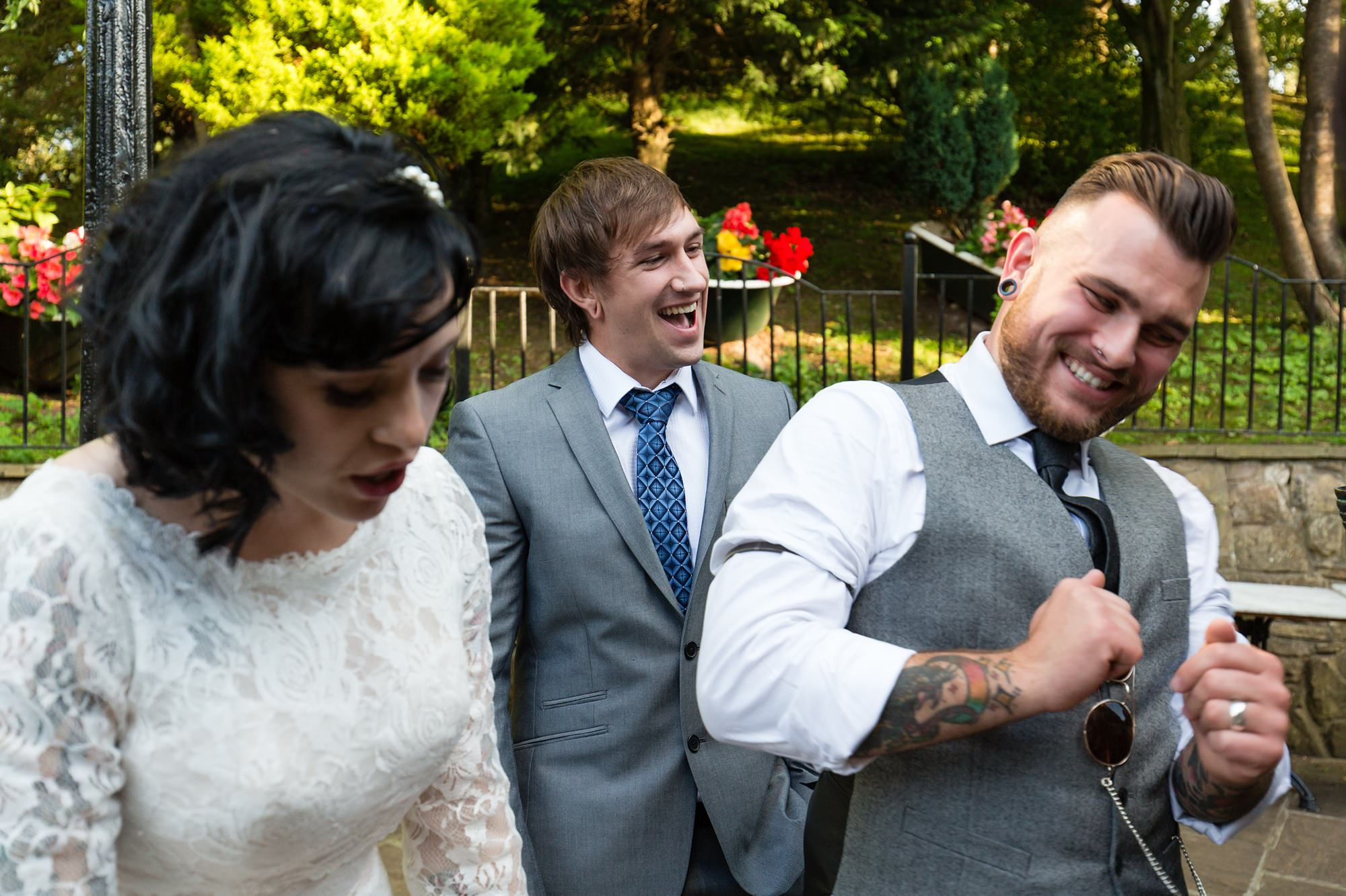 Guest laughs with brides and grooms Yorkshire Wedding Photography at Crab and Lobster