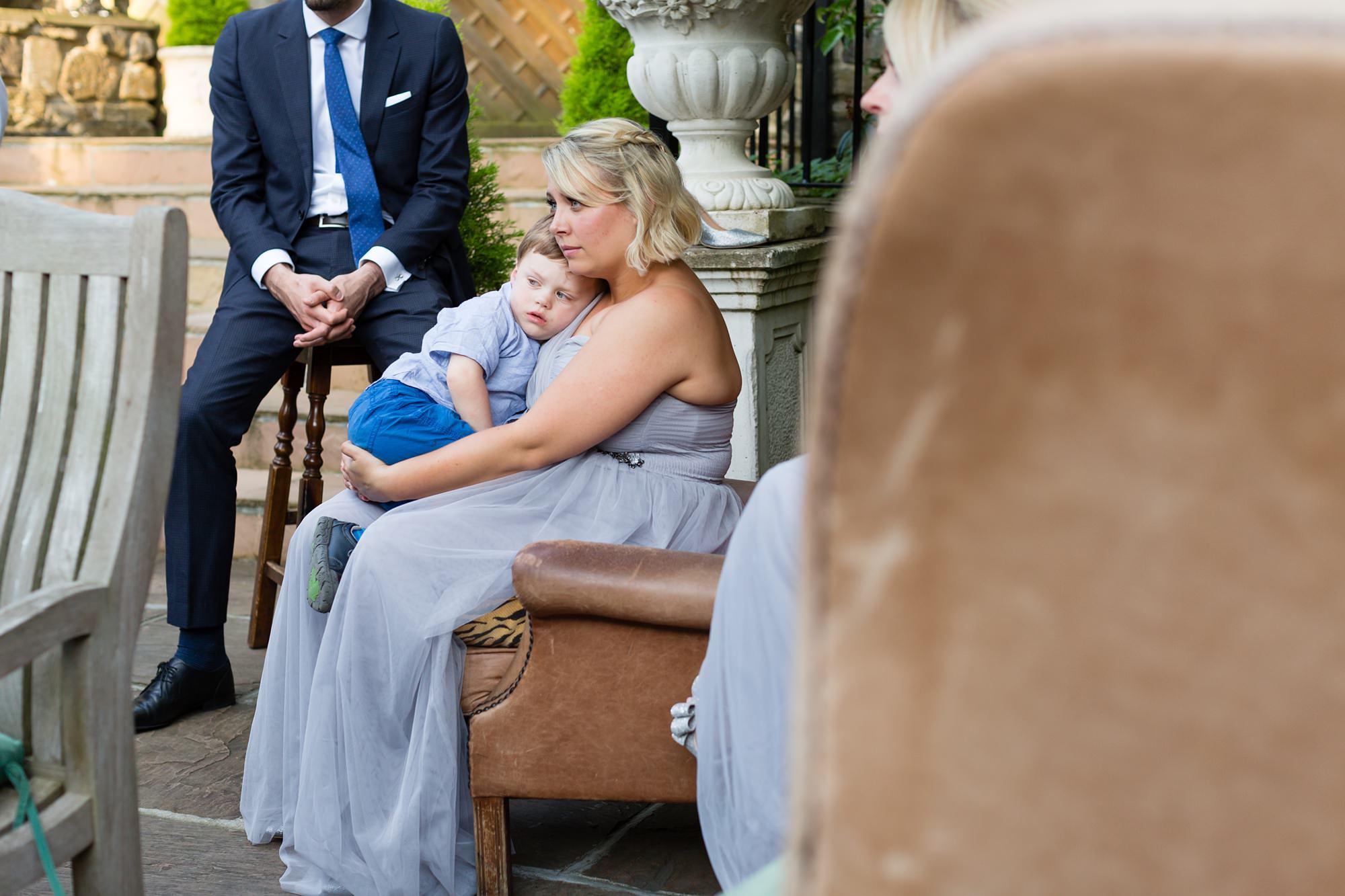 Bridesmaid cuddles son