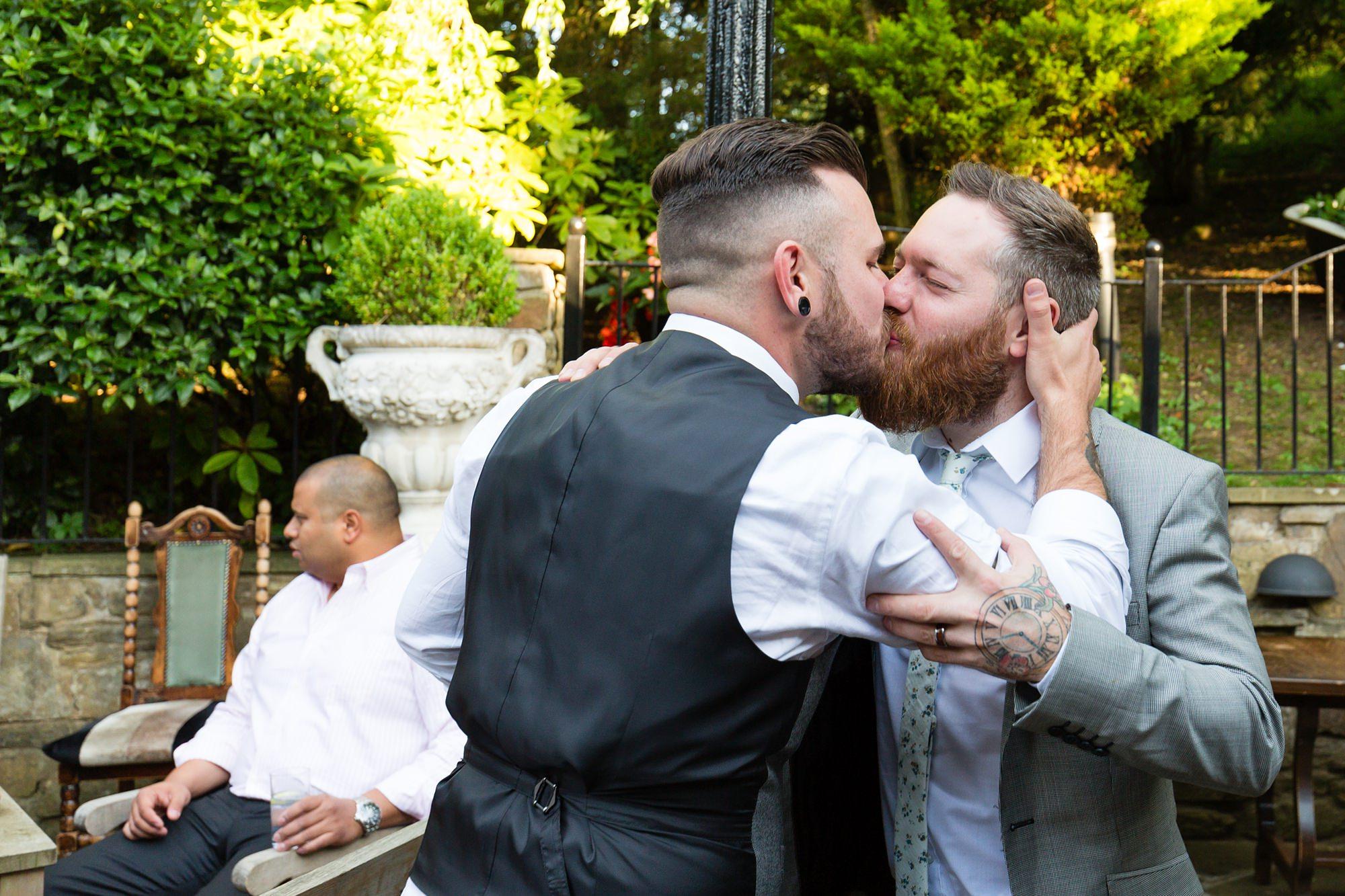 Groom kisses guest