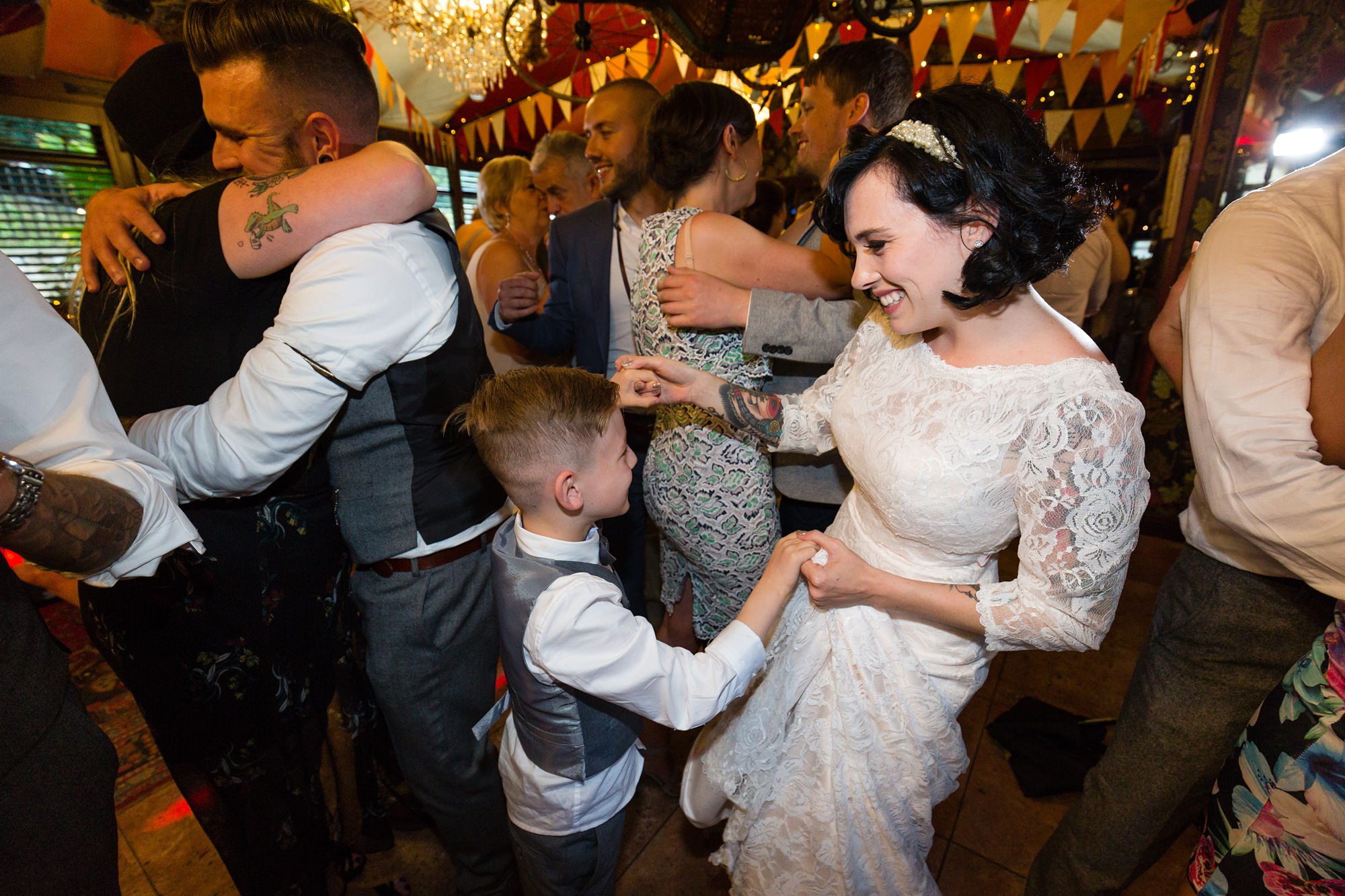 Bride dances with stepson at Crab & Lobster wedding