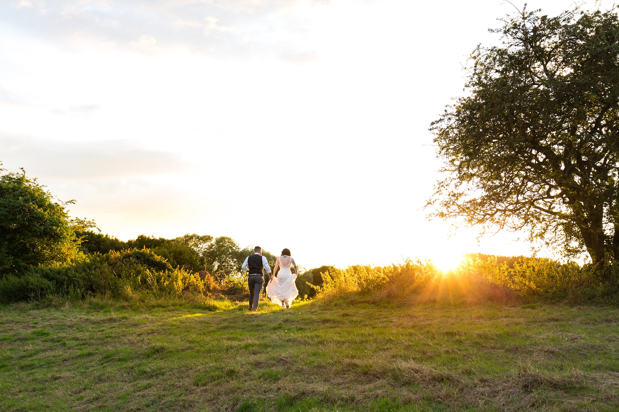 Sunset photography with tattooed bride and groom at Crab & Lobster