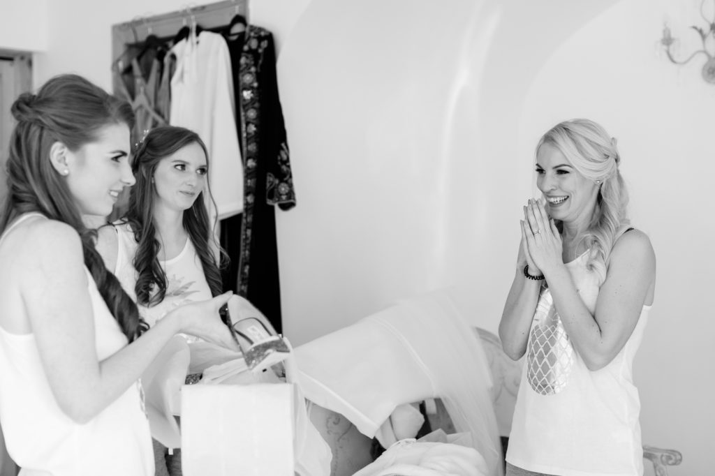 Bridesmaid clapping with happiness in black and white wedding photograph