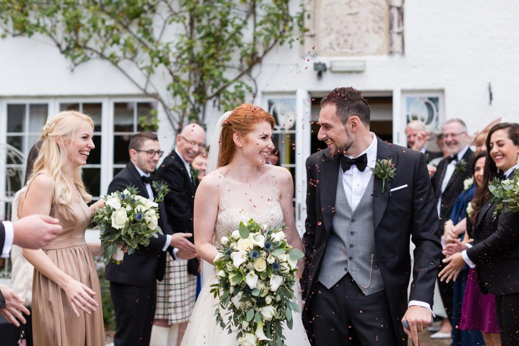 Confetti with rose petals with redheaded bride at Achnagairn Estate wedding