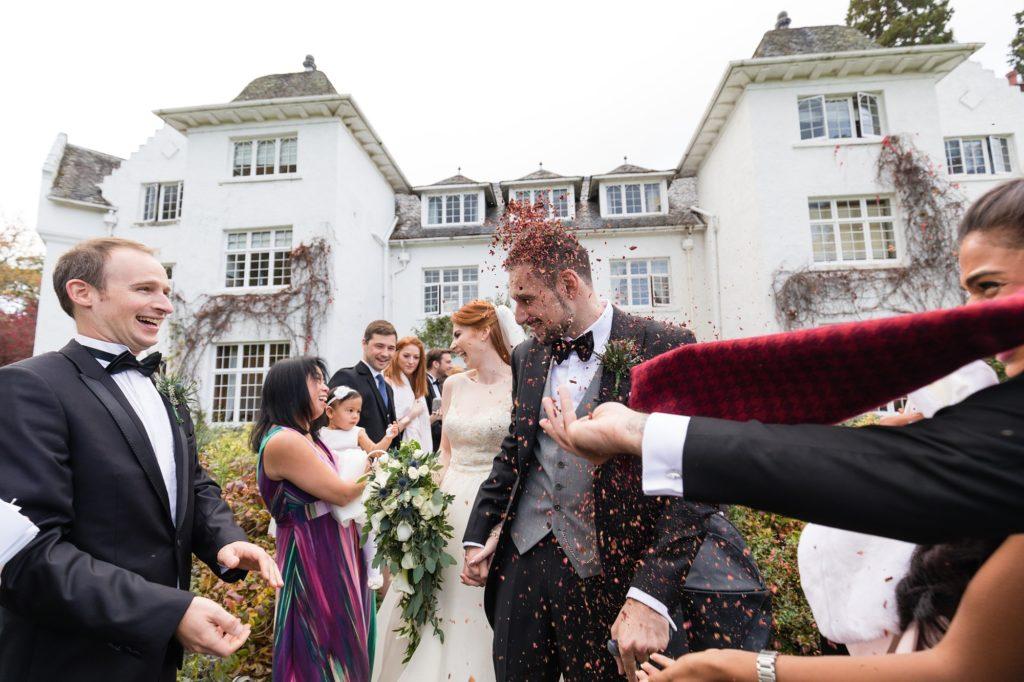 Groom getting confetti bombed at Achnagairn Estate