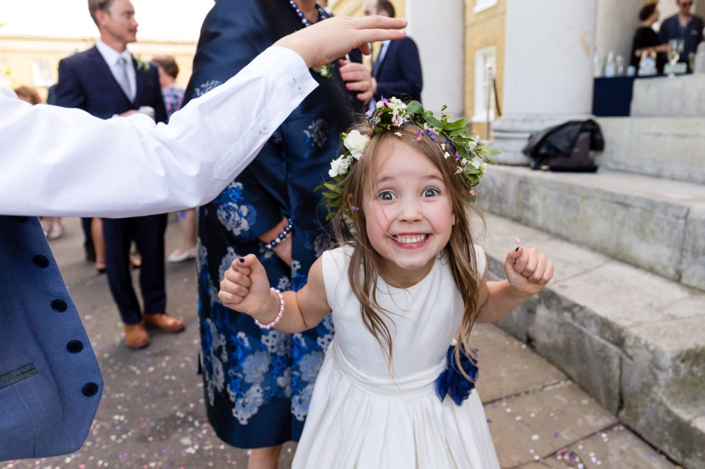 Flower girl covered in confetti at Asylum wedding.