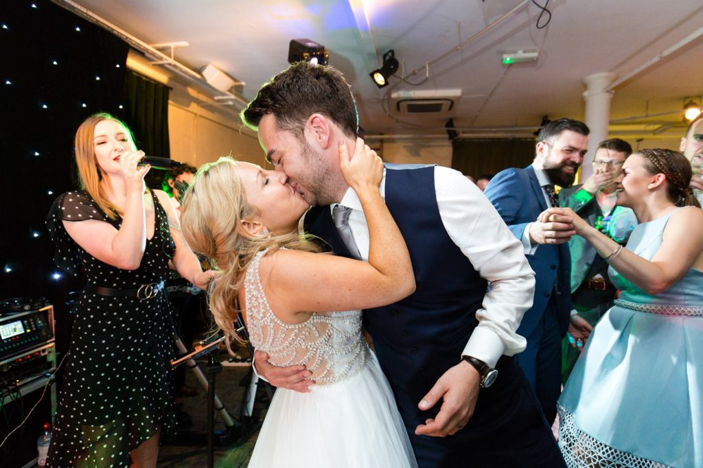 Bride & groom kiss on the dance floor at London wedding.