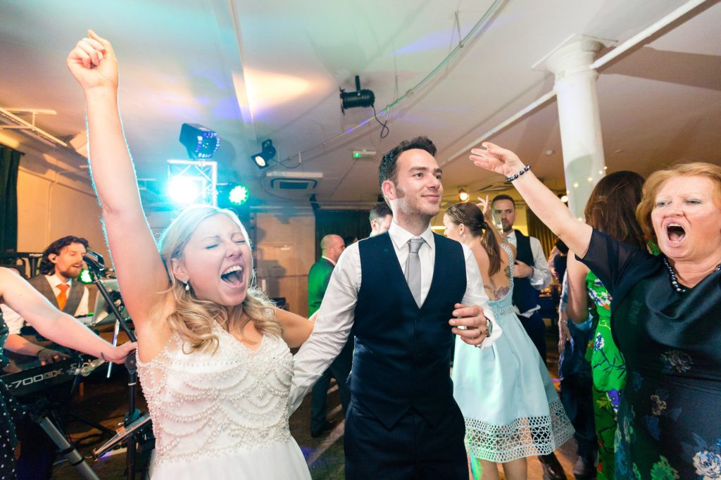 Bride dances with abandon at London wedding.