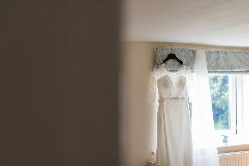 White wedding dress in window at Yorkshire wedding