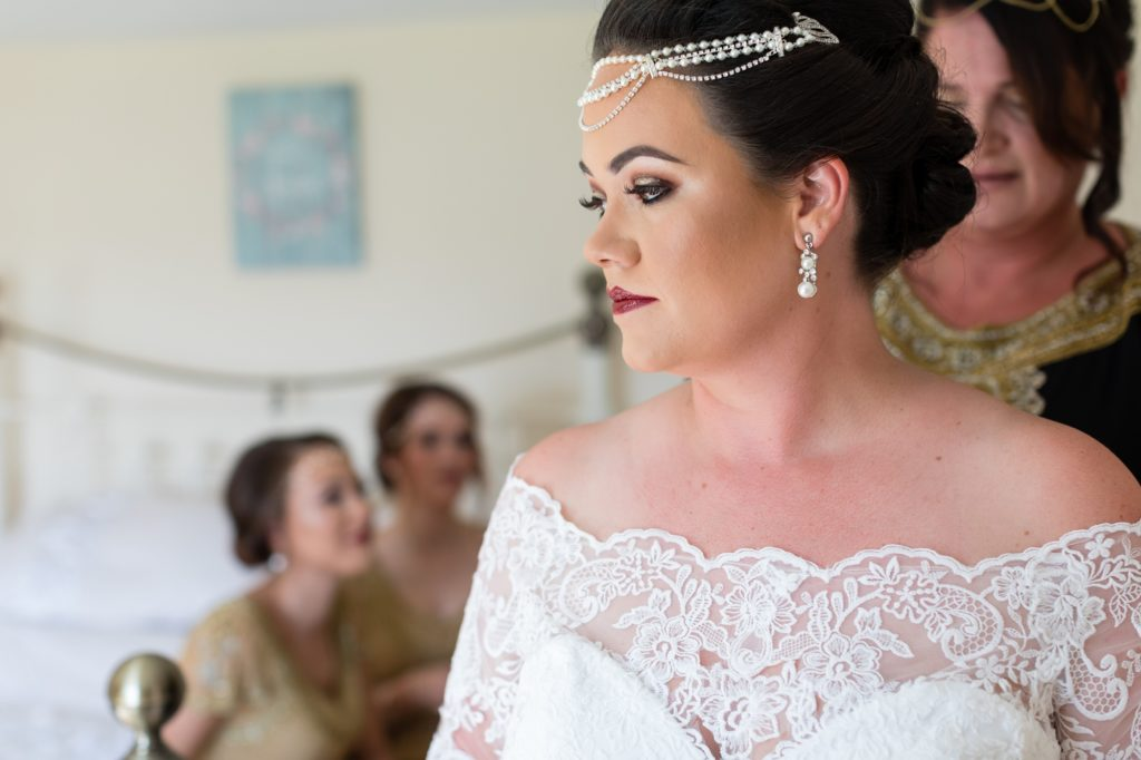 Art Deco style wedding with bride getting dressed in Yorkshire Wedding.