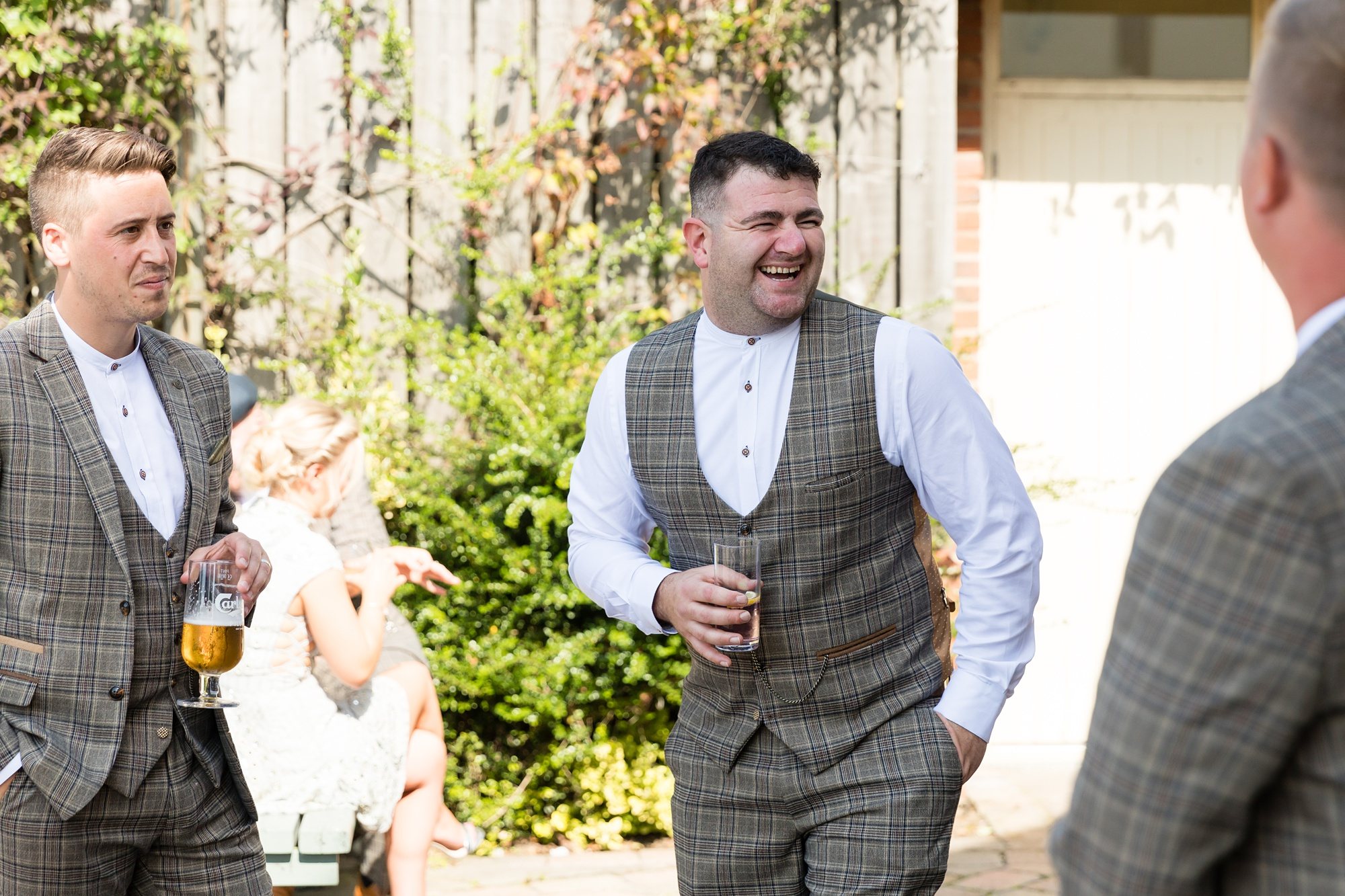 Groomsmen laugh at Sandburn Hall wedding.