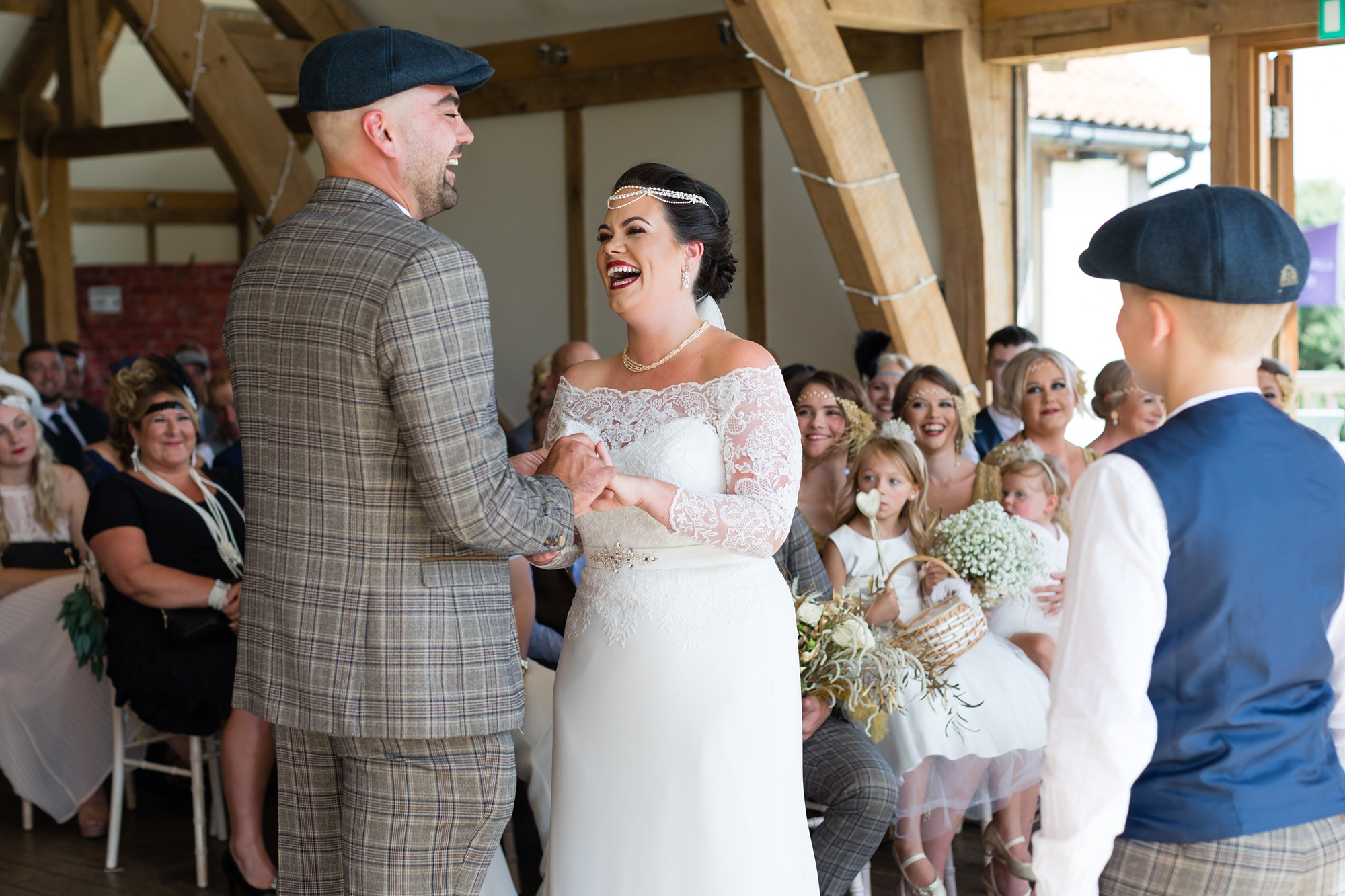 Bride laughs as the couple exchange rings at Sandburn Hall wedding.