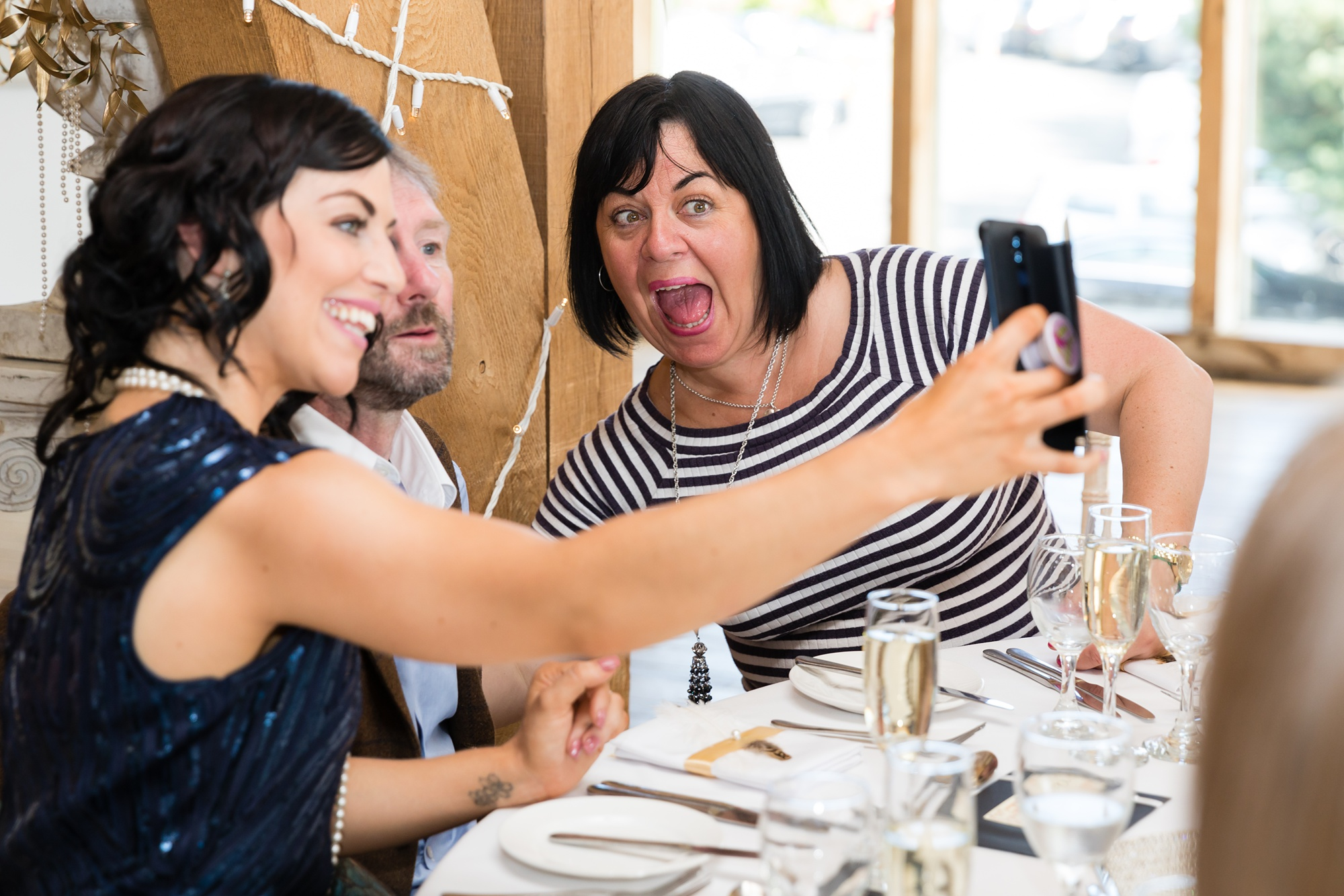 Guests take a selfie at York wedding.