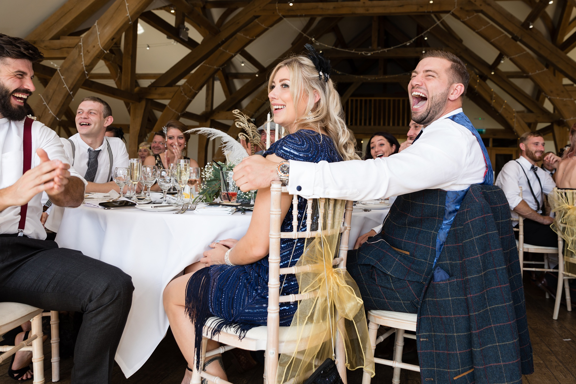 Guests laughing during wedding speeches at York wedding.