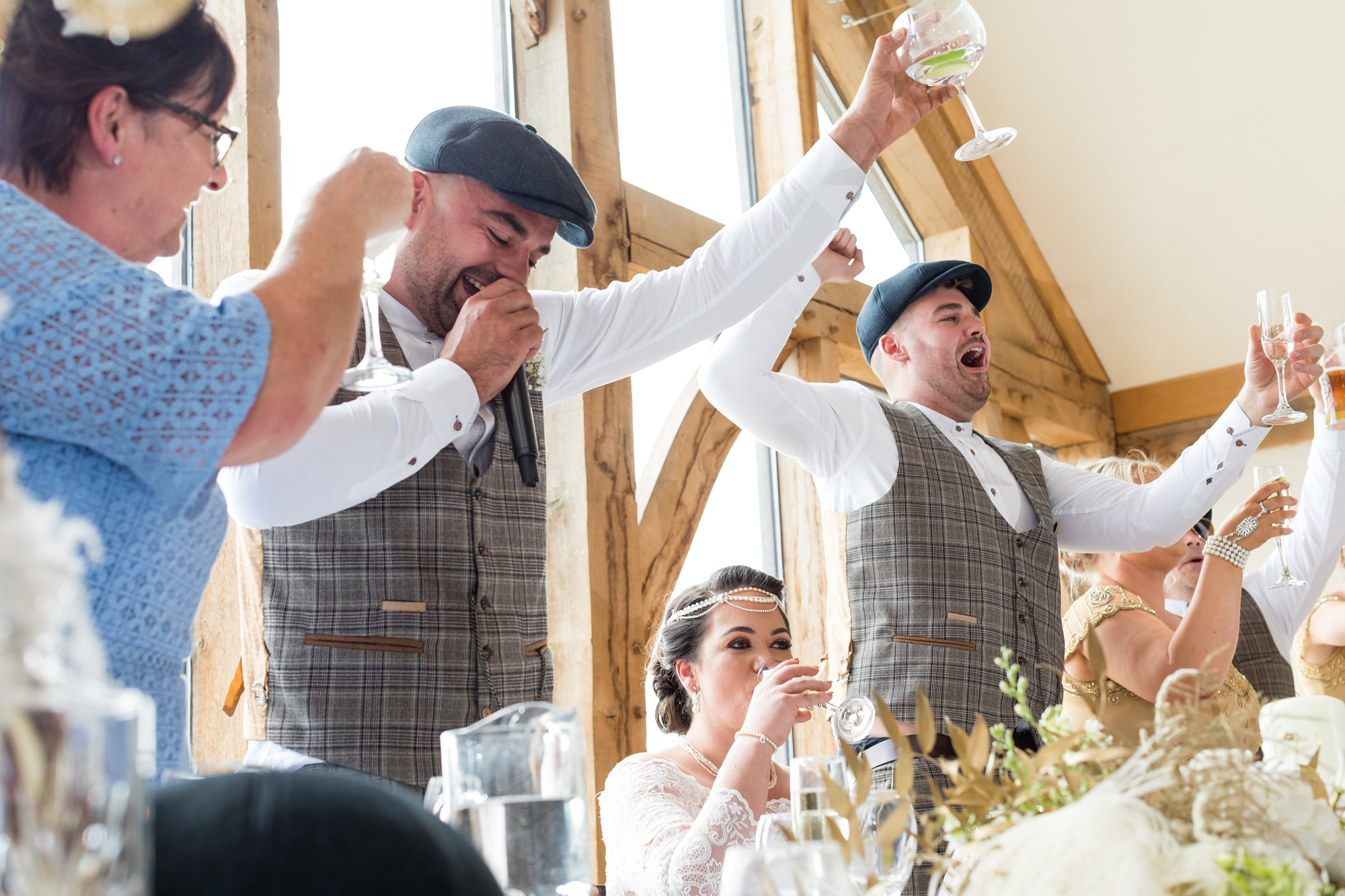 Raising glasses for a toast at Sandburn Hall Wedding.