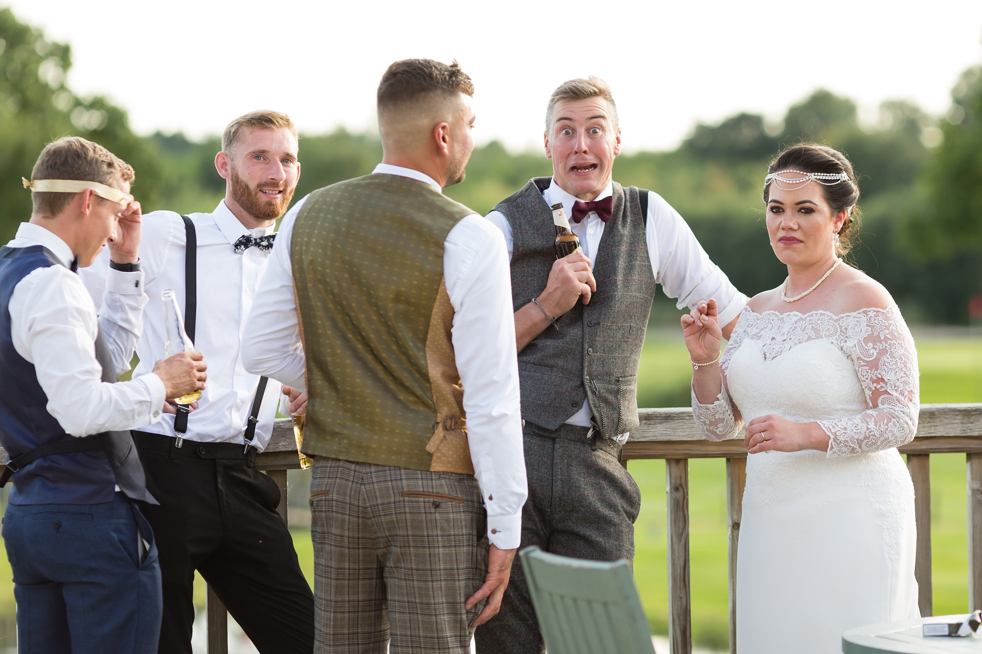 Guest makes funny face for the camera at Sandburn Hall wedding.
